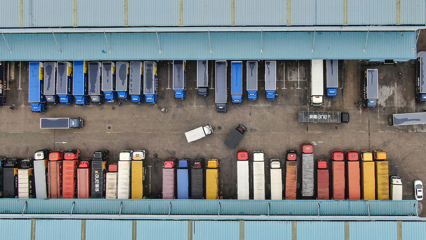This aerial photo taken on June 16, 2020 shows trucks at a logistics center in Nantong, in China's eastern Jiangsu province.