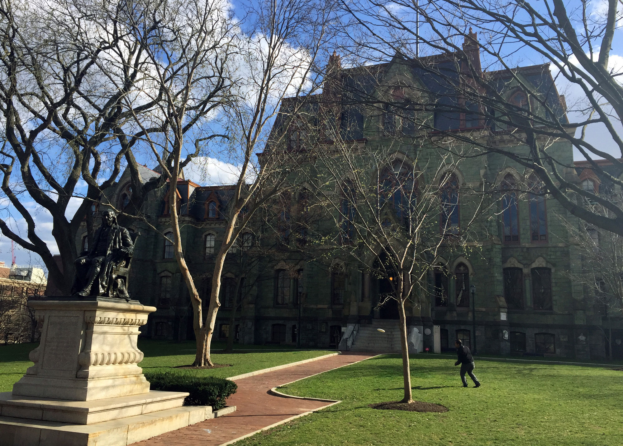 A person walks near College Hall on the University of Pennsylvania campus in Philadelphia on March 20, 2016.