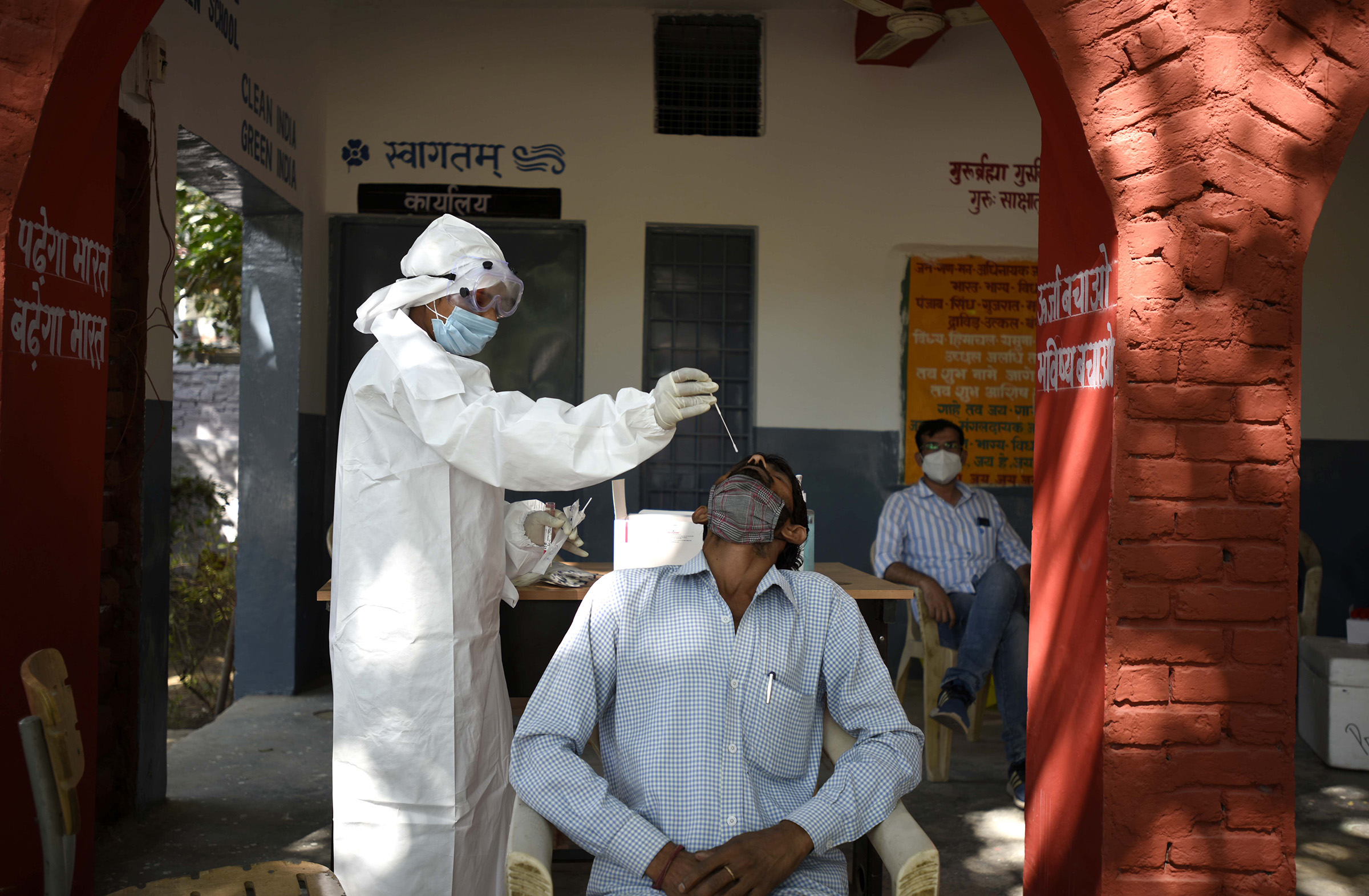 A health worker, collects a swab sample for coronavirus testing at Government Middle School Sector-14, on October 10, in Gurugram, India.