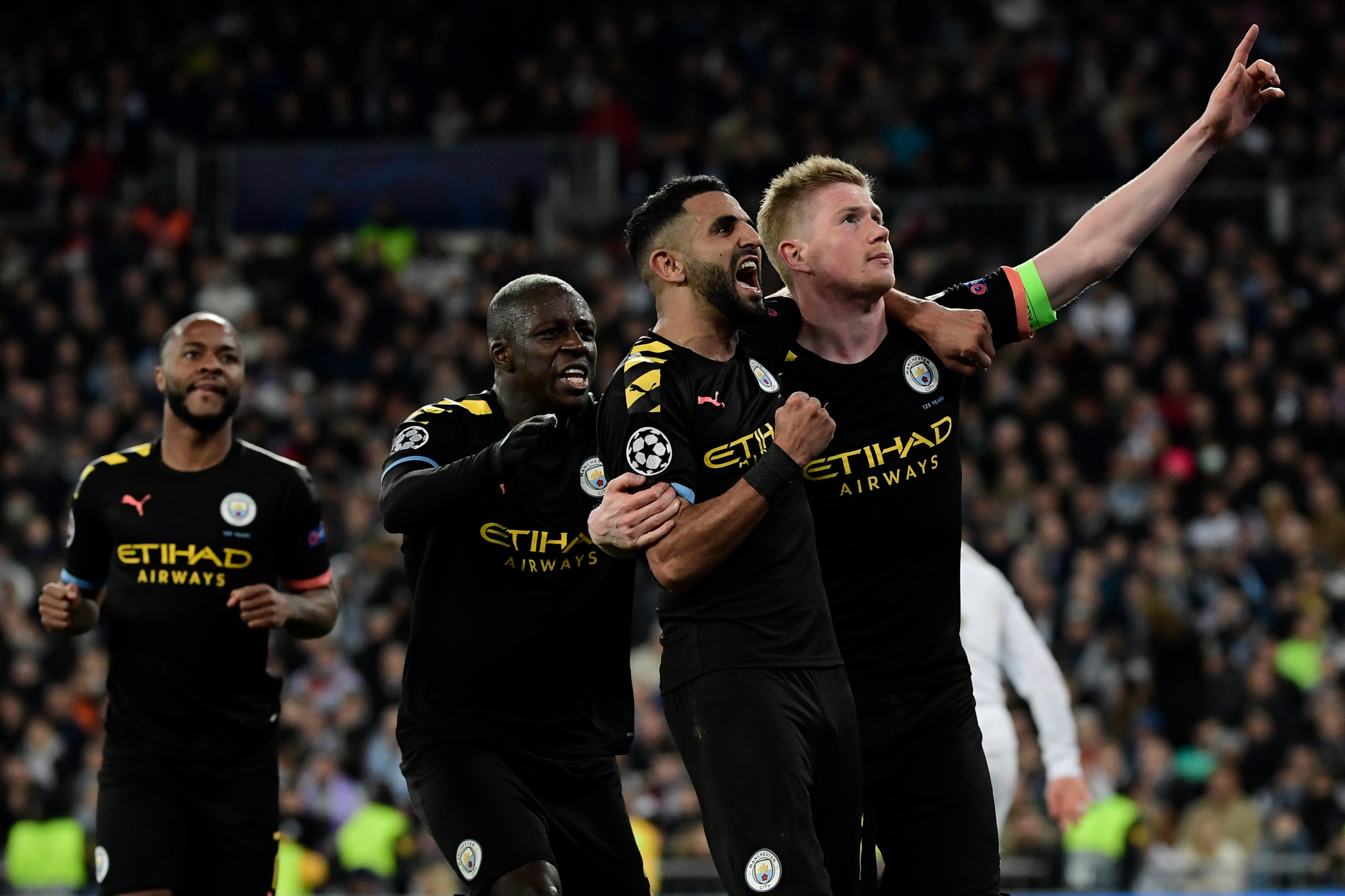 Kevin De Bruyne celebrates his winning penalty.