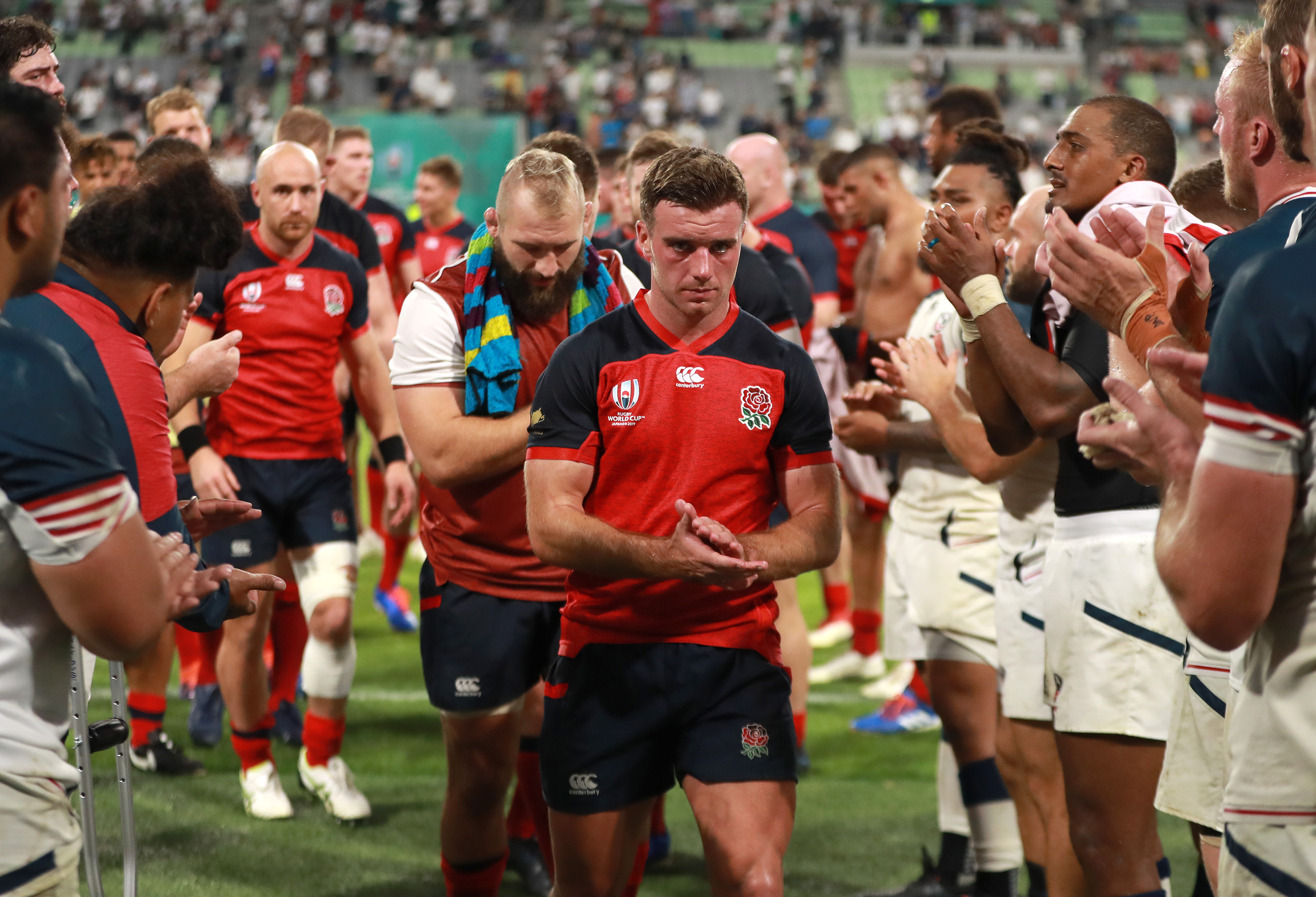 England's George Ford is applauded by USA players in Kobe.