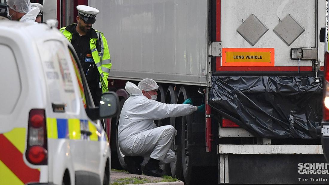 British Police forensics officers work on ther lorry found to be containing 39 dead bodies, at Waterglade Industrial Park in Grays.