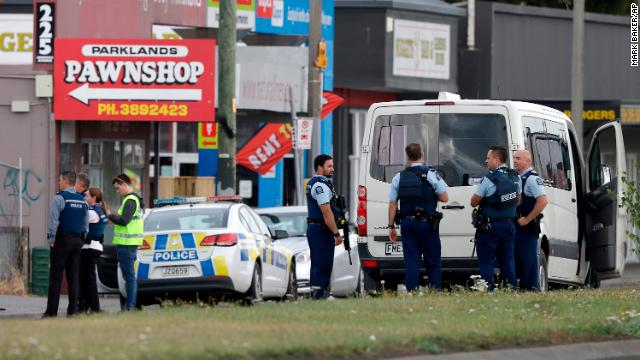 Police stand outside a mosque in Linwood in Christchurch, New Zealand, on March 15. Multiple people were killed during shootings at two mosques full of people attending Friday prayers. (AP/Mark Baker)