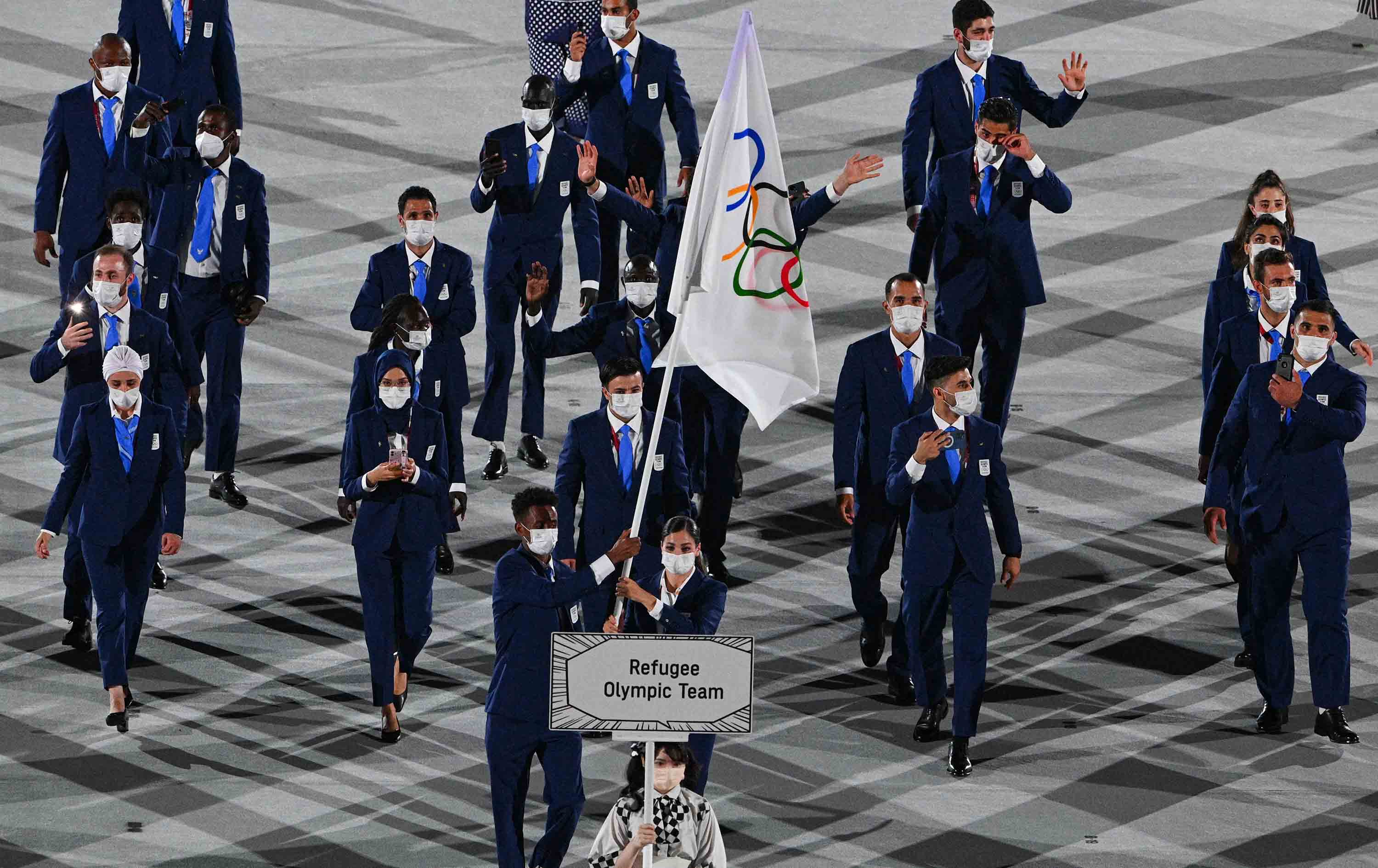 The Refugee Olympic Team parades during the Opening Ceremony.