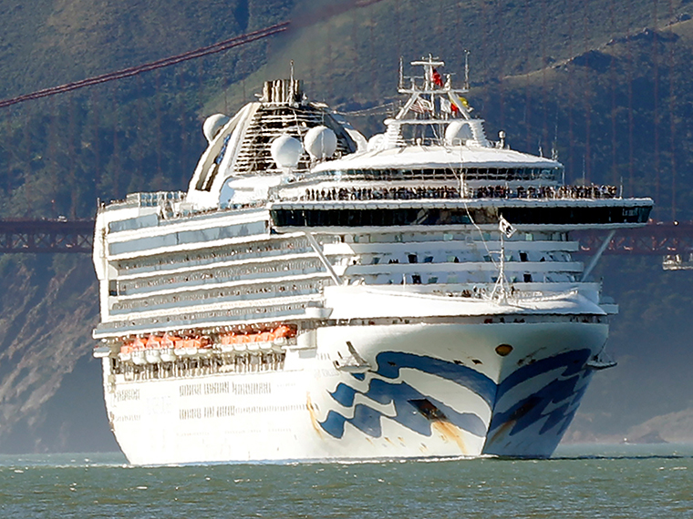The Grand Princess cruise ship passes the Golden Gate Bridge on February 11, as it arrives from Hawaii in San Francisco.