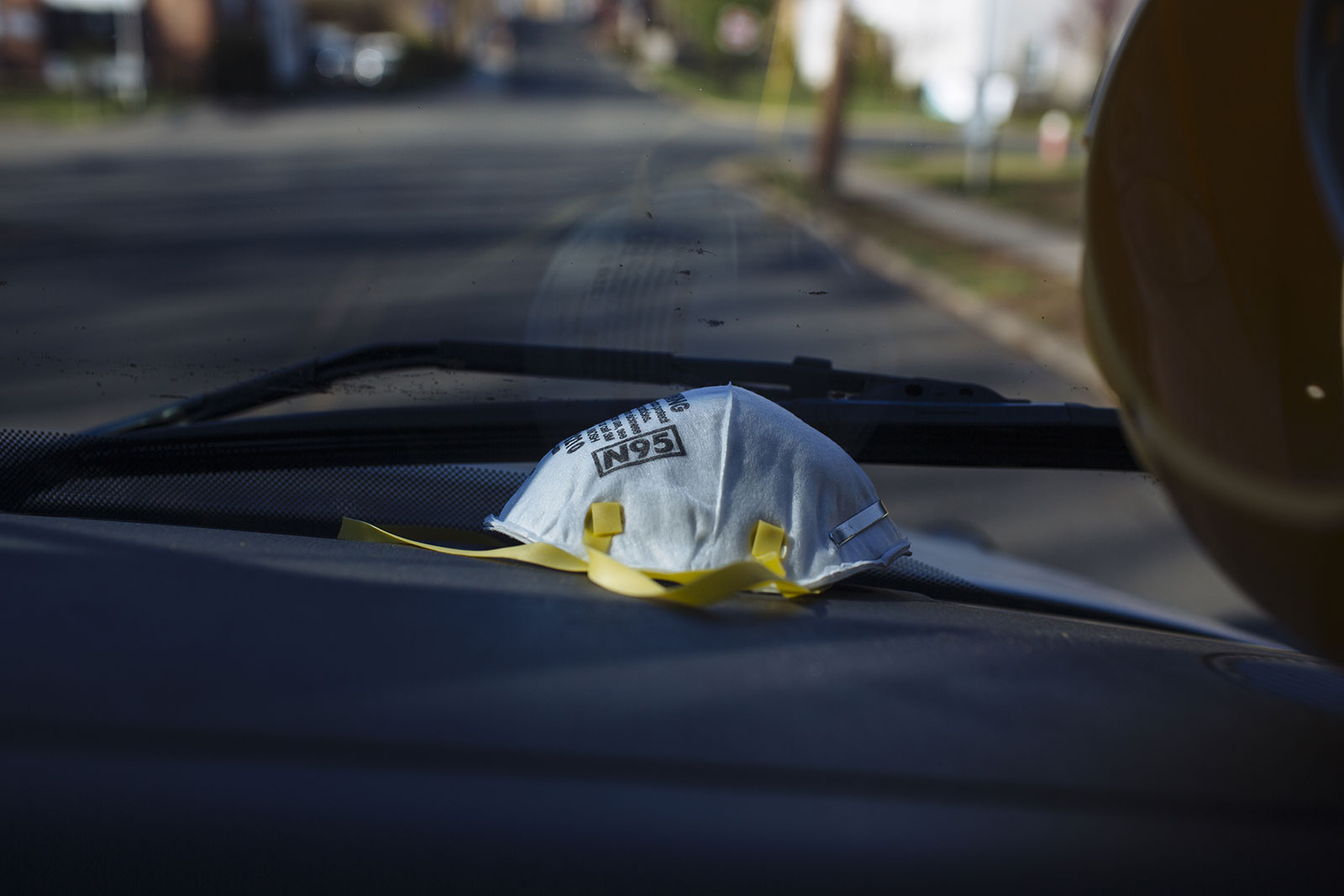 An N95 protective mask sits on the dashboard of an ambulance in Teaneck, New Jersey, on Saturday, April 11.
