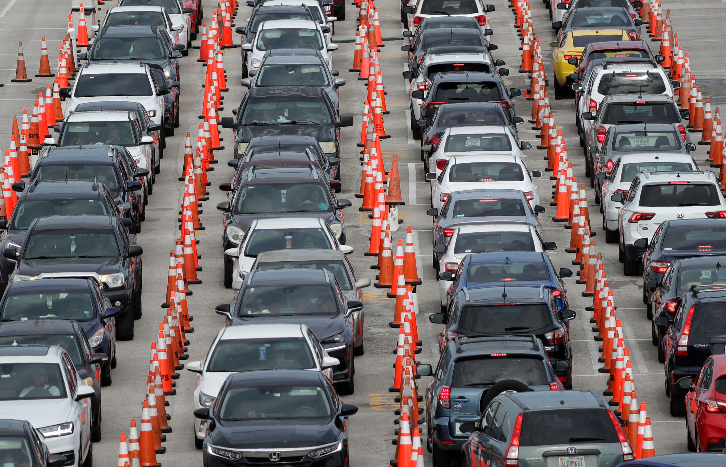 Lines of cars wait at a drive-through coronavirus testing site on July 5 outside Hard Rock Stadium in Miami Gardens, Florida.