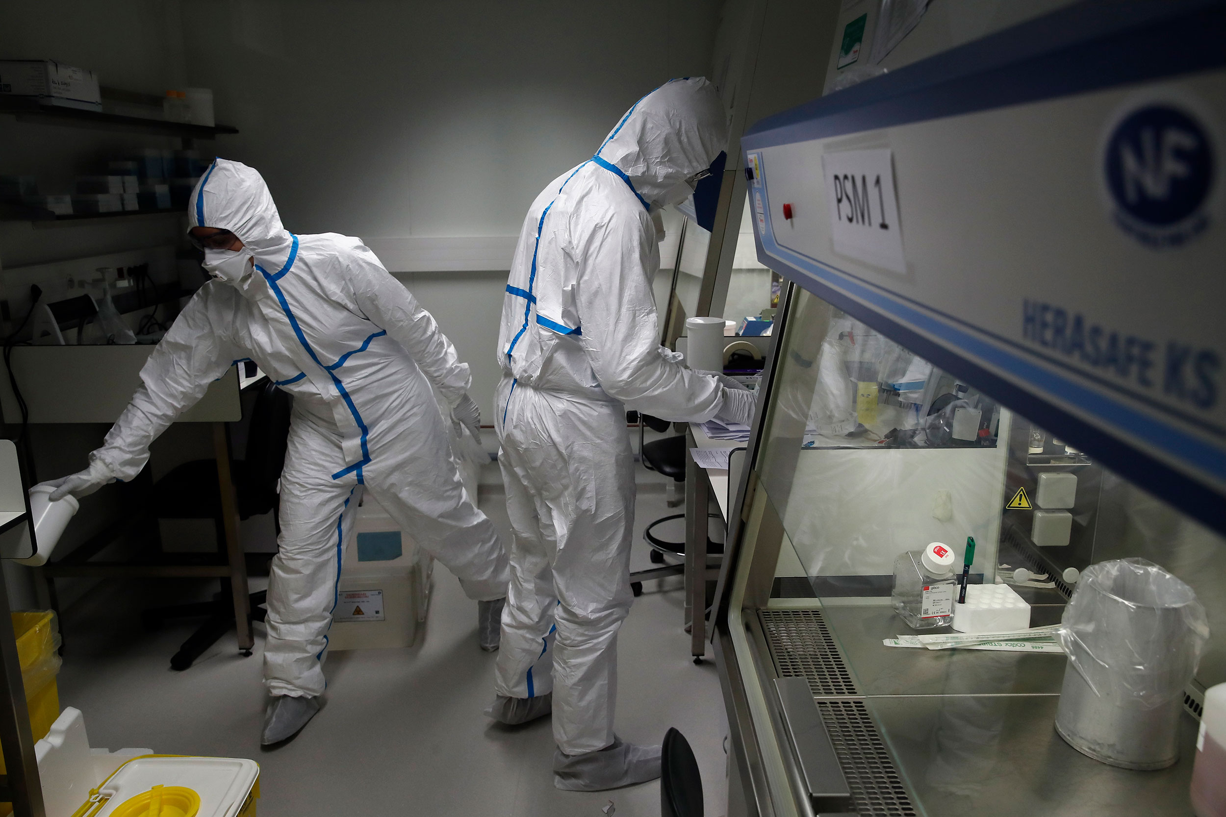 Scientists at the Pasteur Institute in Paris test samples from infected patients.