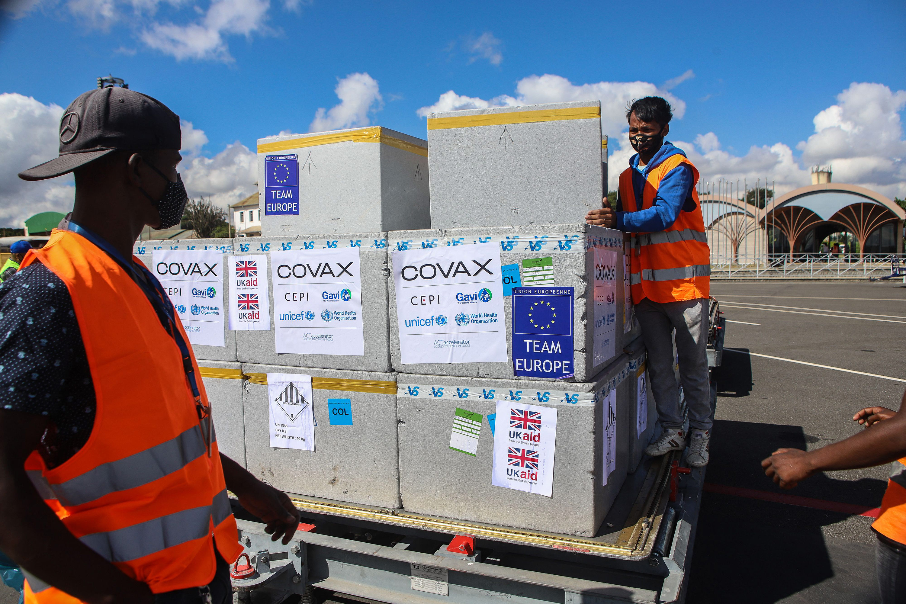 Workers handle boxes of COVAX Covid-19 vaccines at Ivato International Airport in Antananarivo, Madagascar, on May 8.