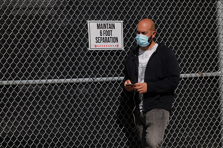 A person waits in line to be tested for COVID-19 at a city test site in the Brooklyn neighborhood of Borough Park on October 05, 2020 in New York City.