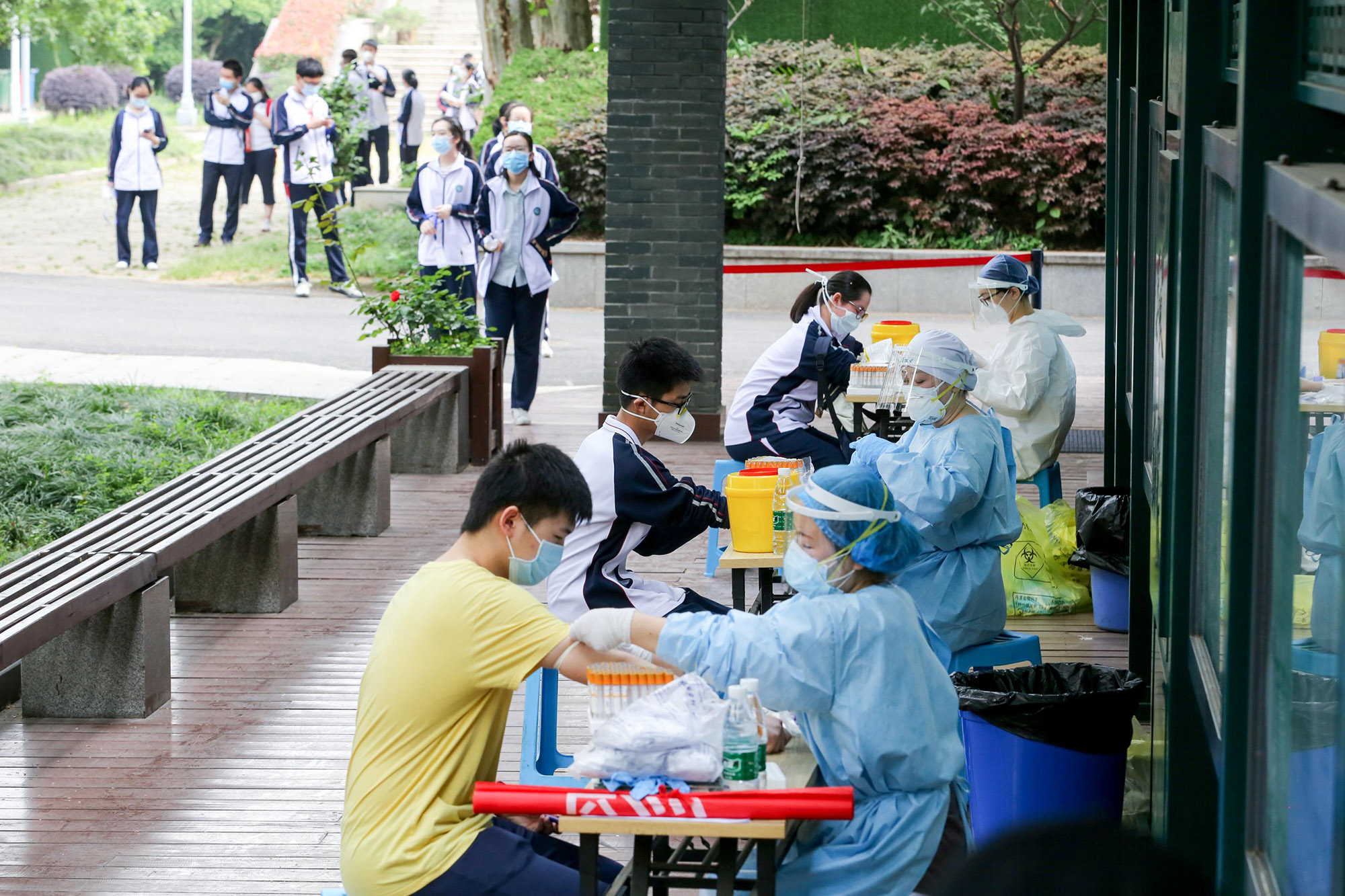 Students in grade three of Hubei Wuchang Experimental High School have their blood taken for nucleic acid and serum antibody tests on April 30, in preparation for classes to resume in Wuhan, China.