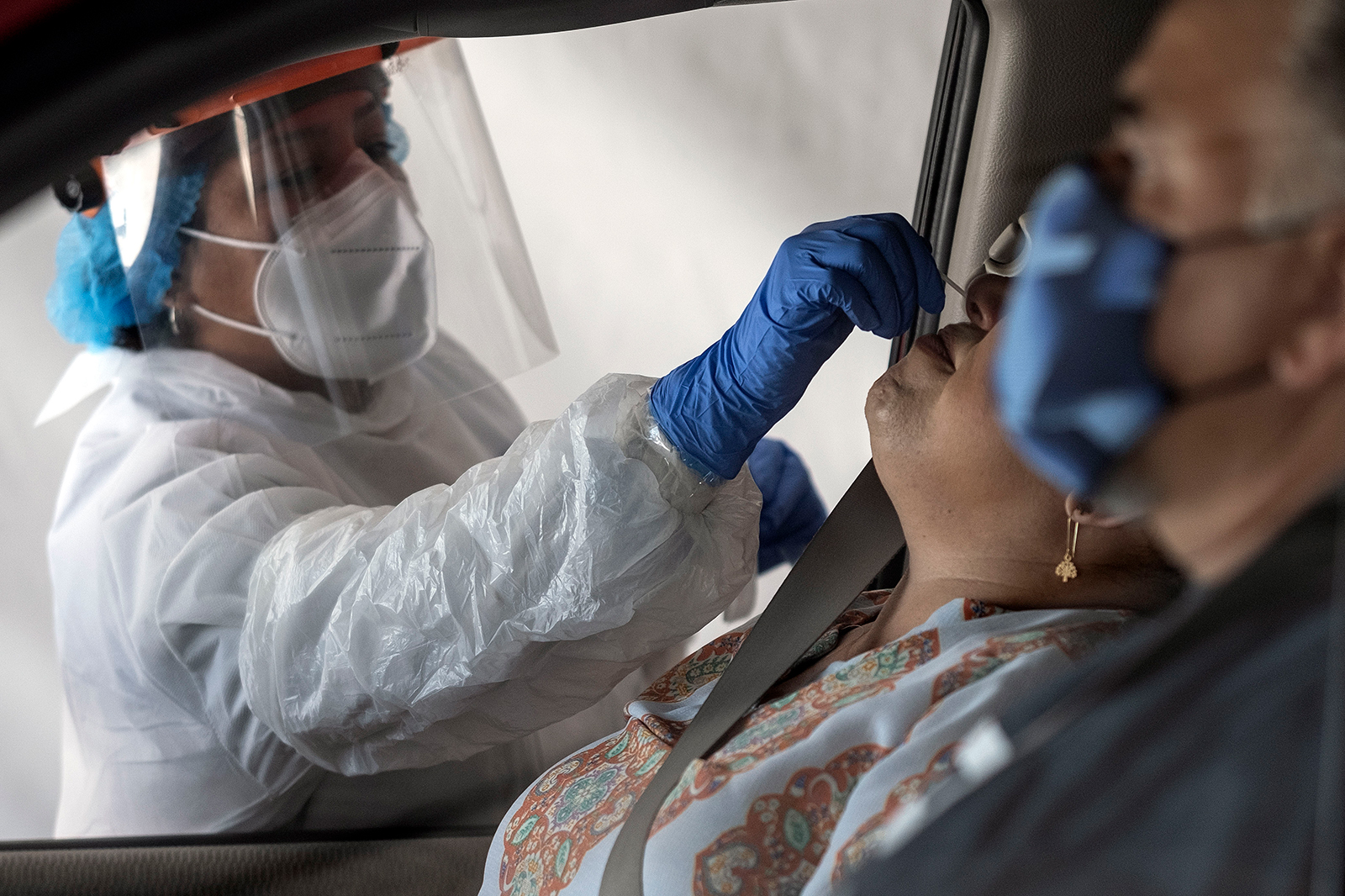 A laboratory worker takes a sample of a person at a Covid-19 drive-thru test center in Tijuana, Baja California State, Mexico, on July 21.
