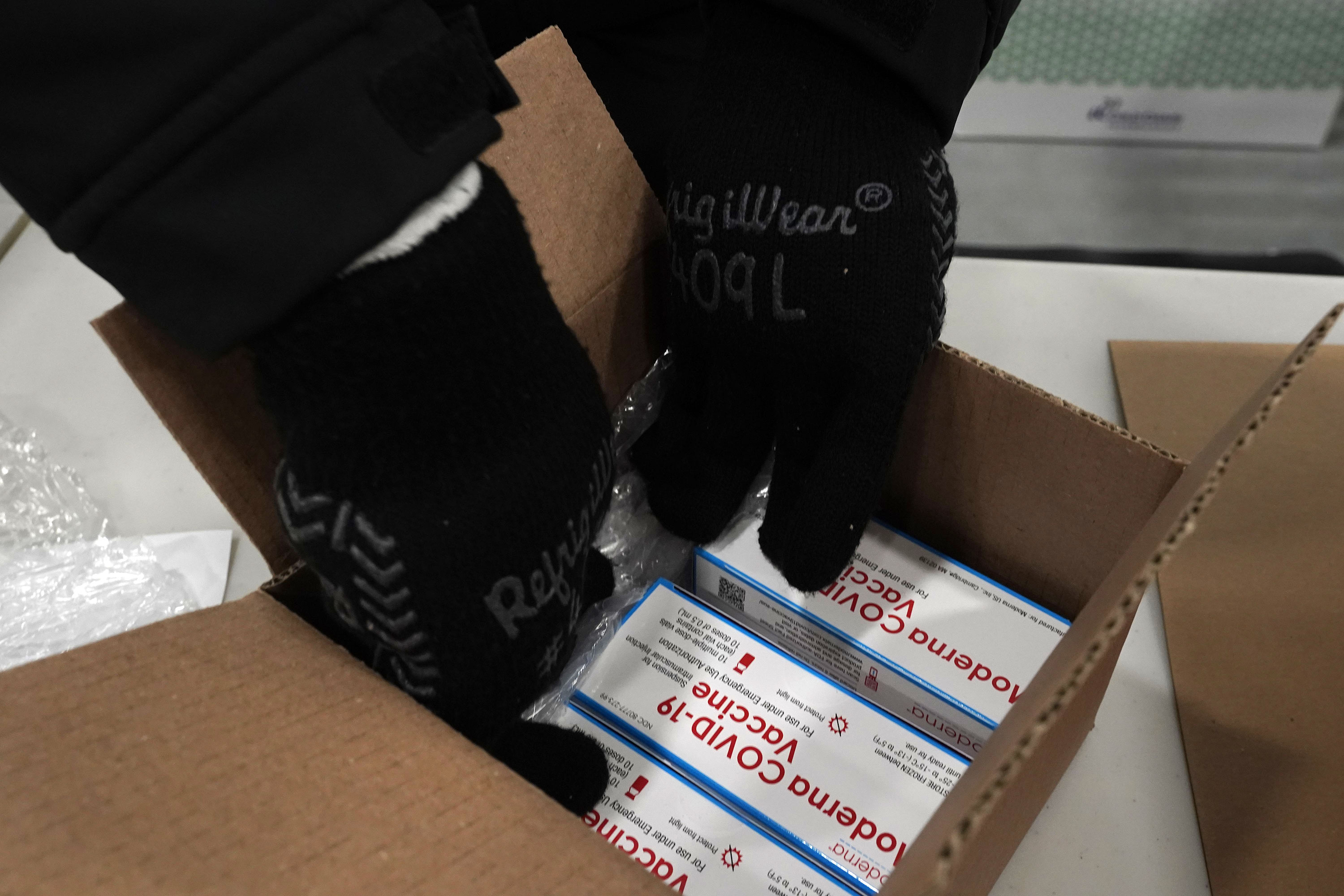 Boxes containing the Moderna Covid-19 vaccine are prepared to be shipped at the McKesson distribution center in Olive Branch, Mississippi, on December 20.