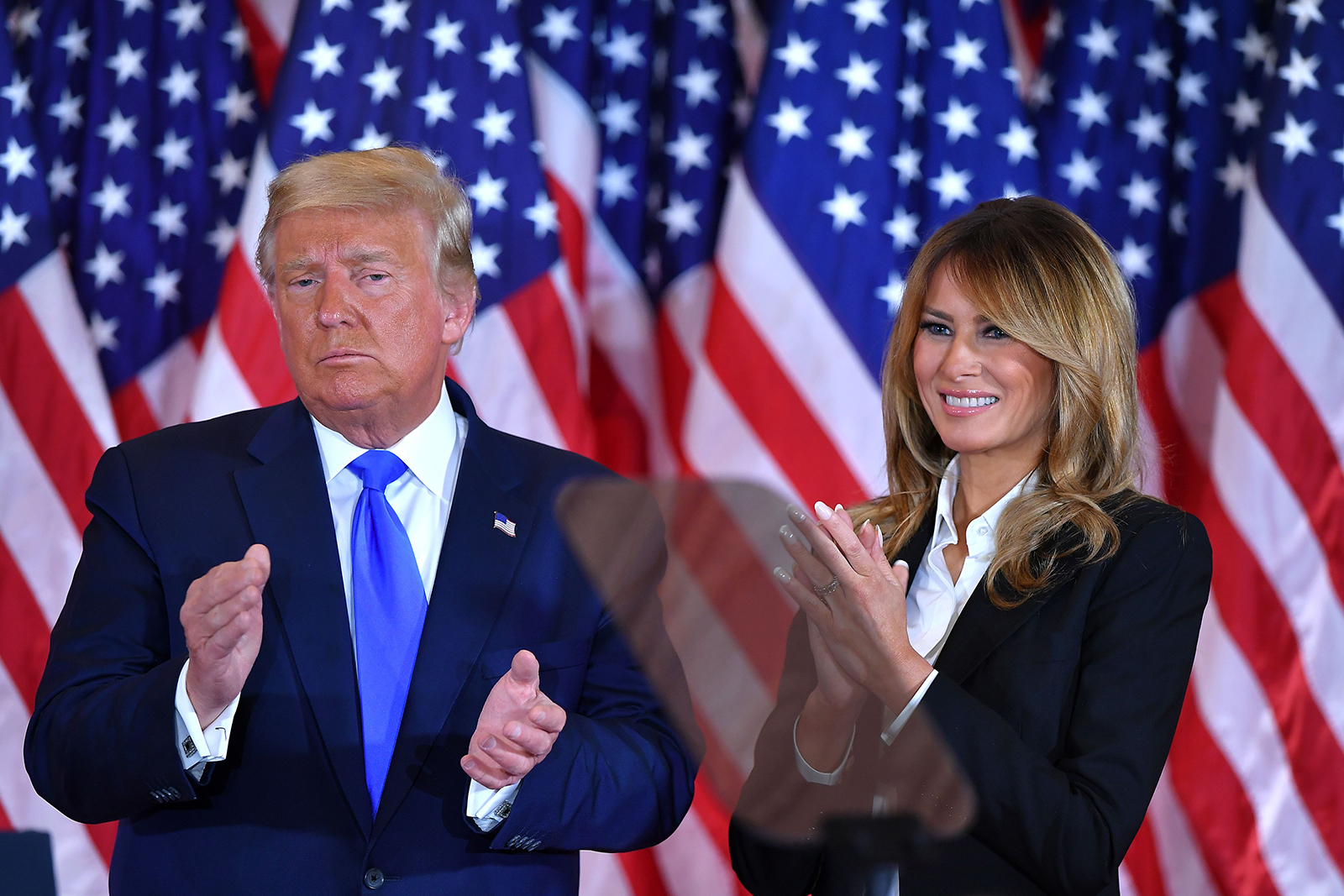 President Donald Trump claps alongside First Lady Melania Trump after speaking during election night in the East Room of the White House in Washington, DC, early on November 4.