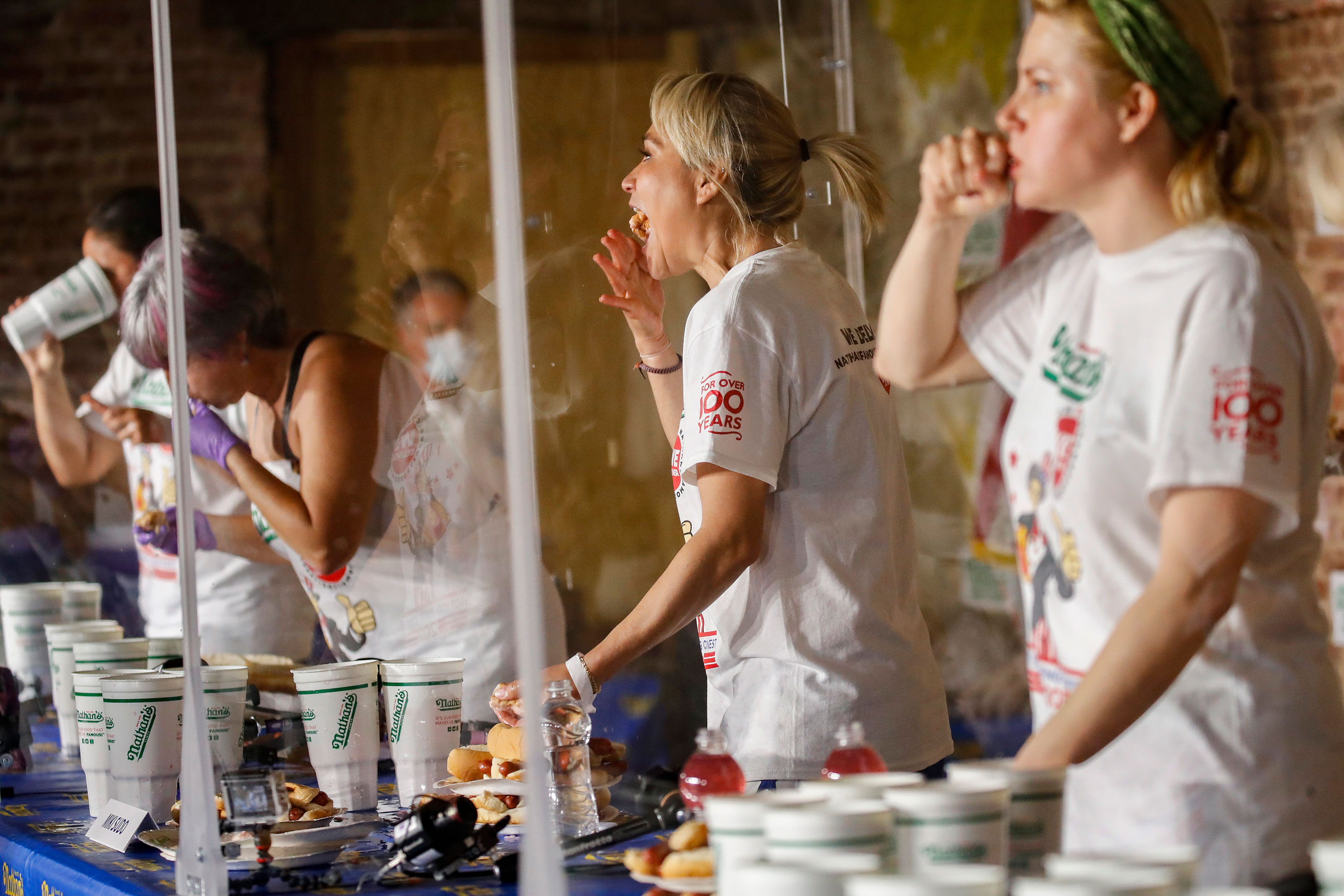 Competitive eater Miki Sudo, center, competes in the women's division of the Nathan's Famous July Fourth hot dog eating contest on July 4 in New York.