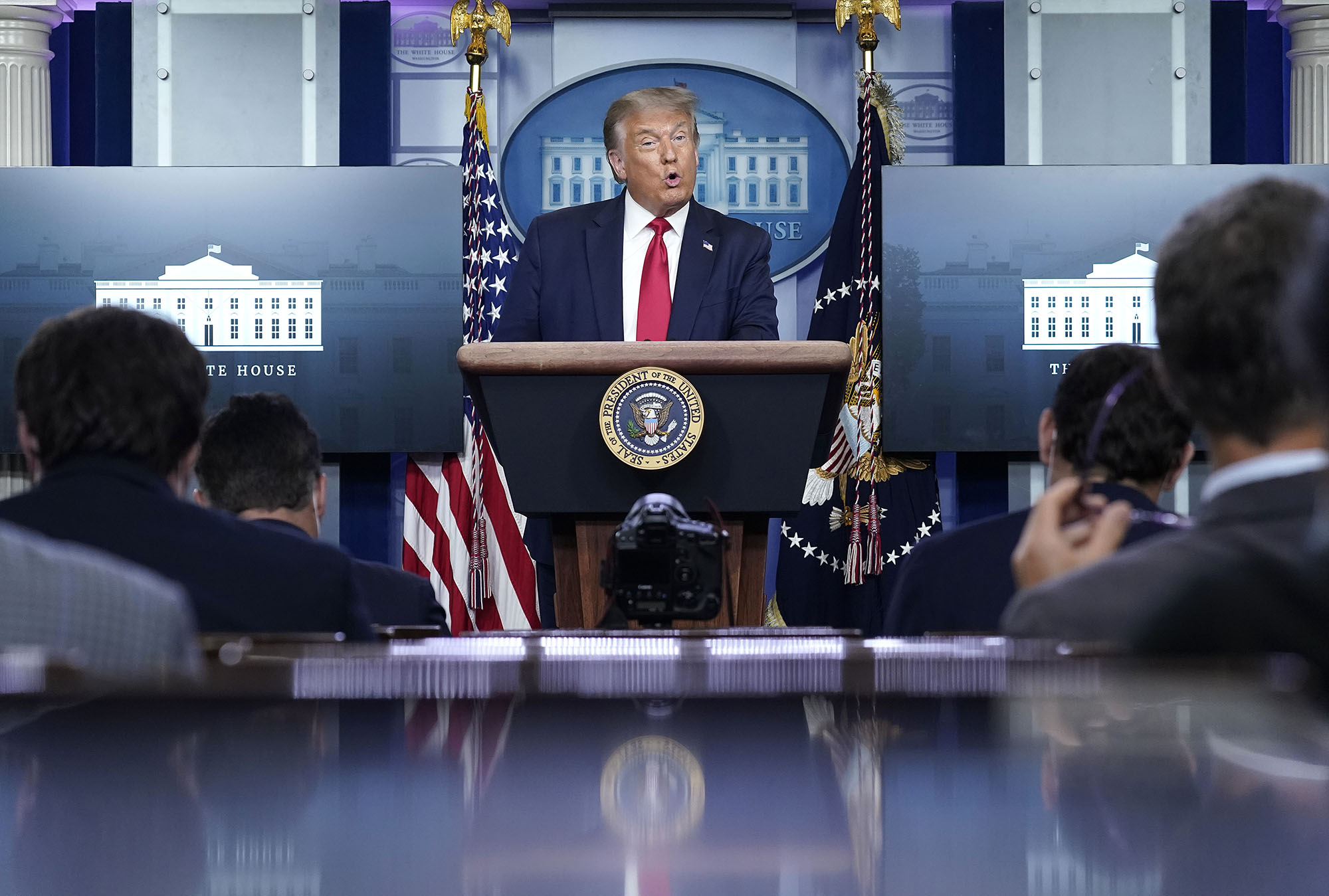 President Donald Trump speaks at a press conference on Monday, August 3, in Washington.
