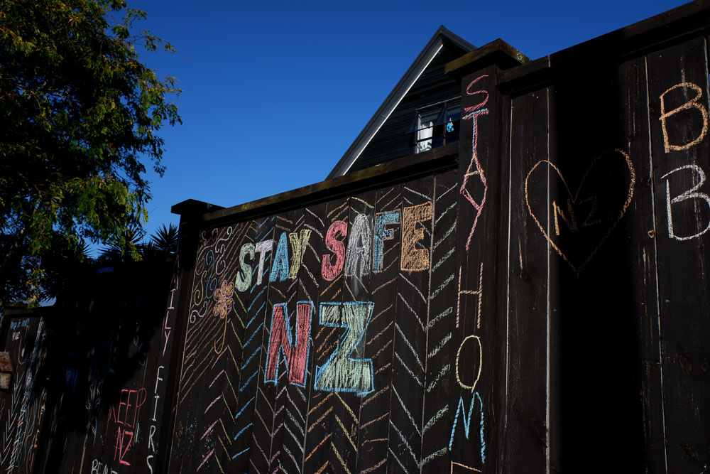 A house fence has been chalked up with messages relating to the coronavirus lockdown on April 3 in Auckland, New Zealand.