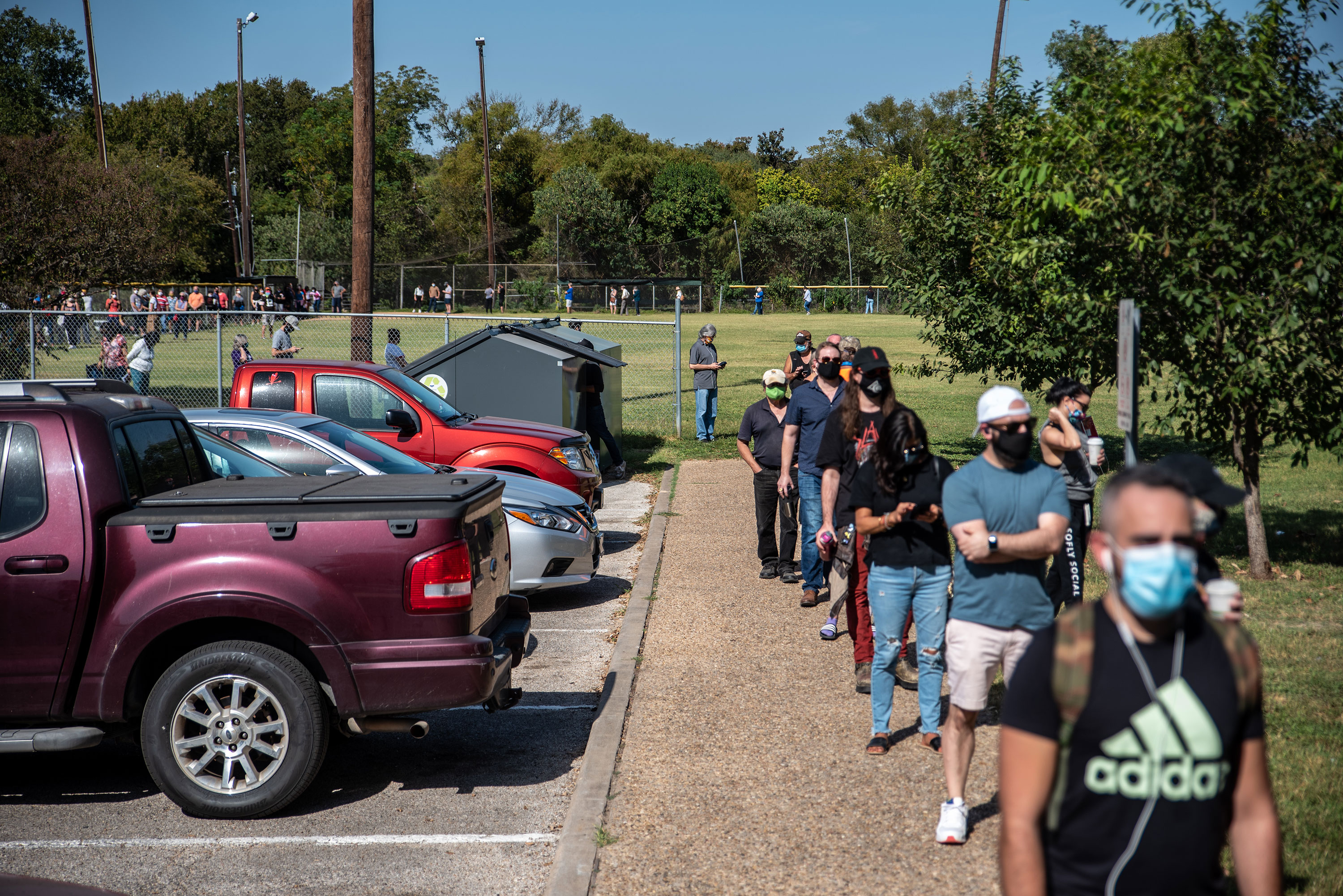 Voters wait in line to vote in Austin, Texas, on October 13.