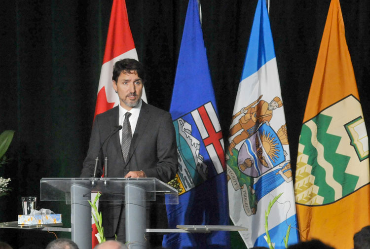 Canadian Prime Minister Justin Trudeau speaks on Sunday in Edmonton at a memorial service for the victims of the Ukraine International Airlines flight 752 crash in Iran.