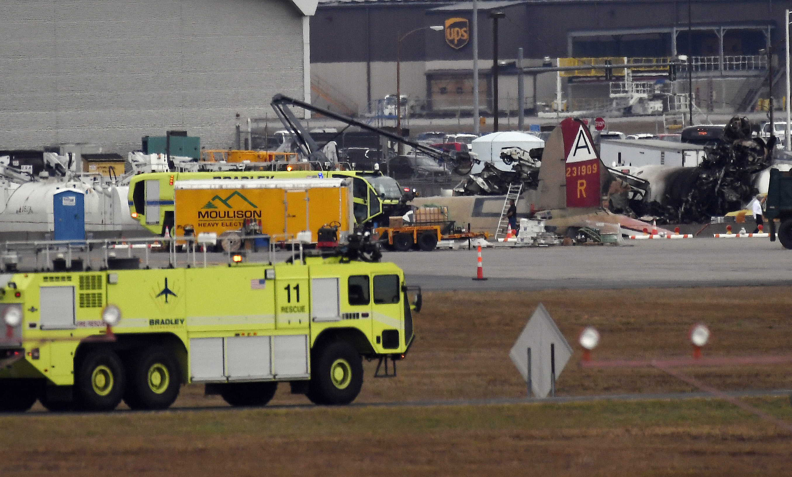Emergency crews respond to a crash involving a World War II-era bomber B-17 plane at Bradley International Airport in Windsor Locks, Connecticut, on Oct. 2, 2019.