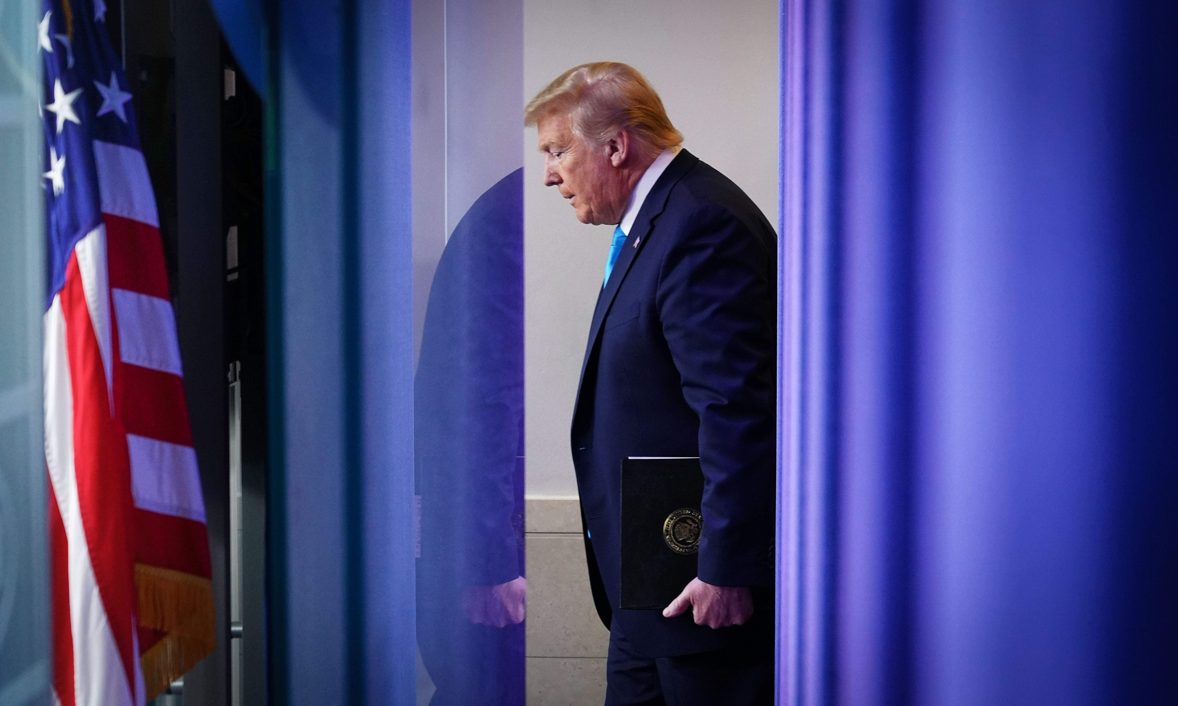 President Donald Trump arrives for a daily briefing on the novel coronavirus at the White House on April 7.