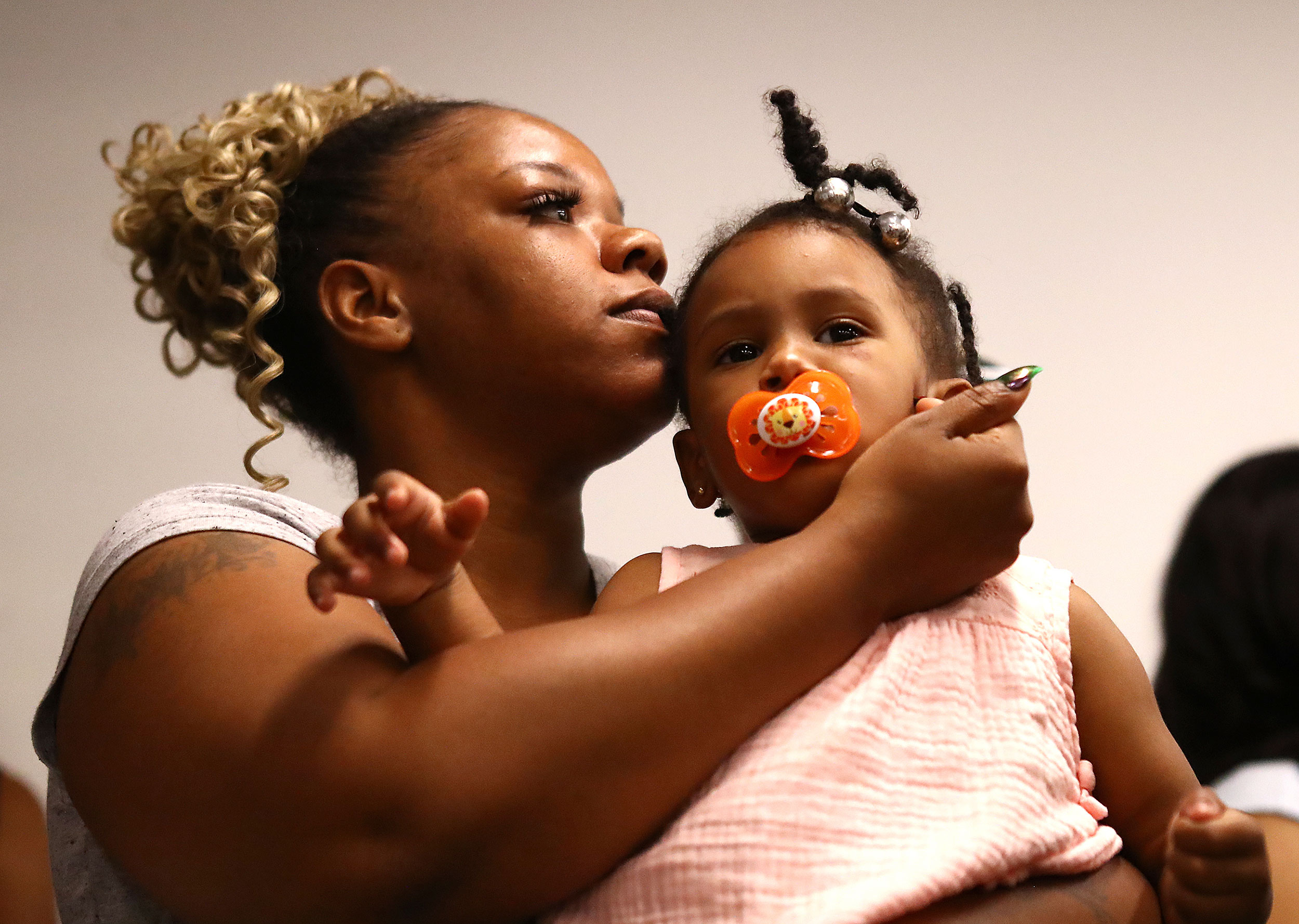 Tomika Miller, the widow of Rayshard Brooks, holds their daughter Memory during a press conference in Atlanta on Monday, June 15.