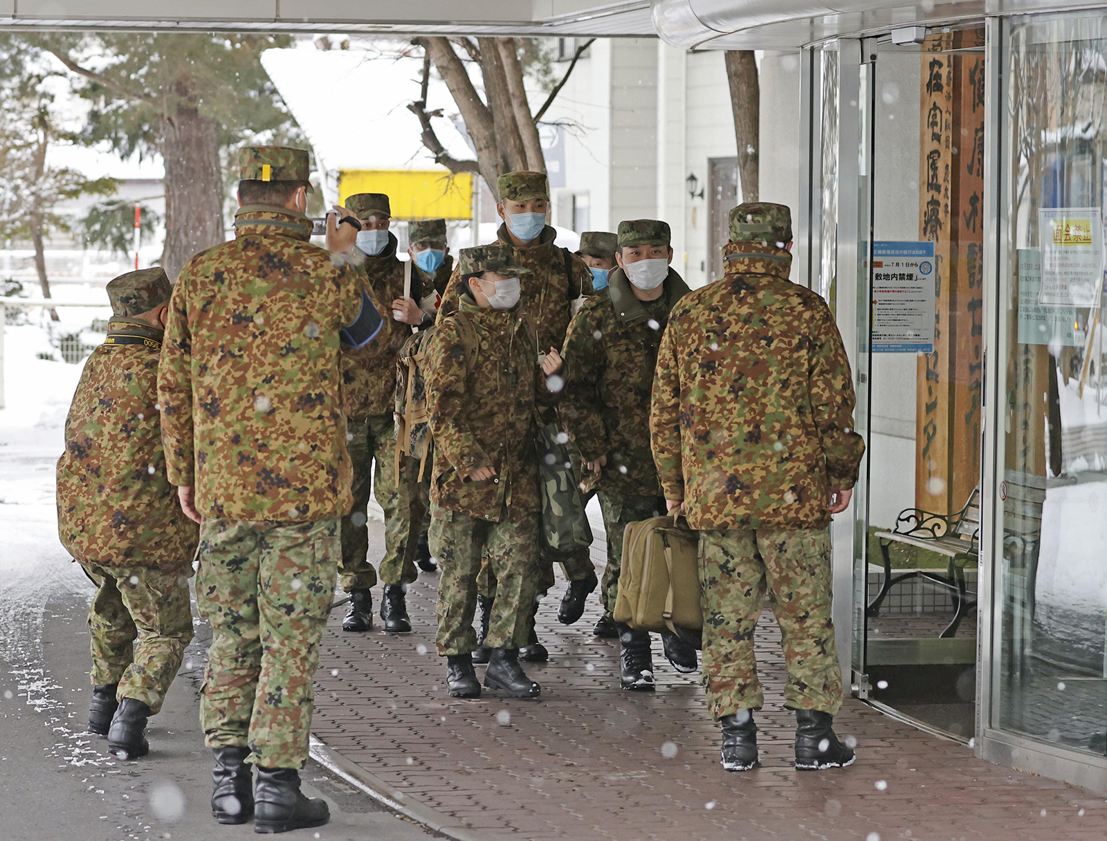 Nurses from the Japan Self-Defense Forces arrive at Yoshida Hospital in Asahikawa, Hokkaido, on Dec. 9.