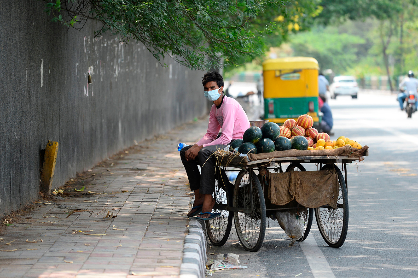 A fruit vendor waits for customers in New Delhi on May 31.