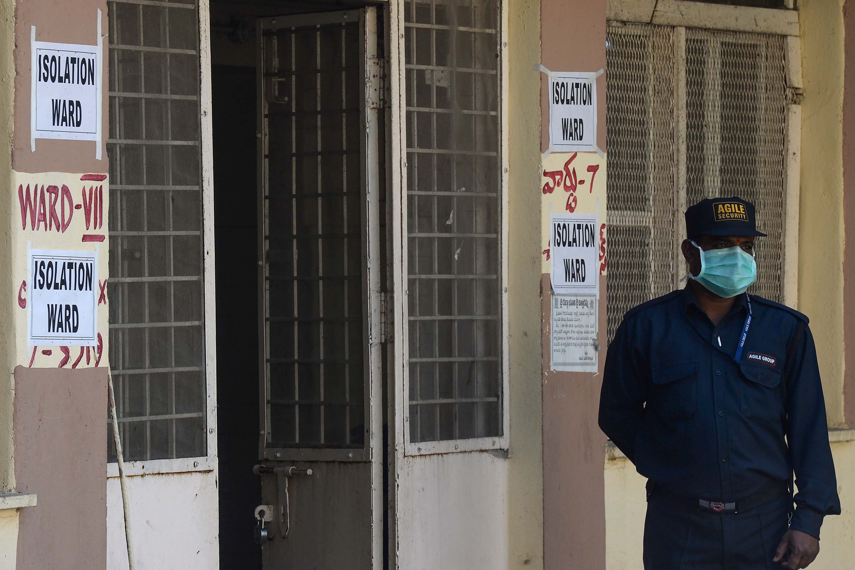 A security guard stands outside a preventive isolation ward for patients arriving from Hong Kong at a government hospital in Hyderabad, India, on January 27