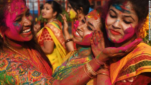 Indian students smear colored powder during an event to celebrate the Hindu festival of Holi in Kolkata in 2018.