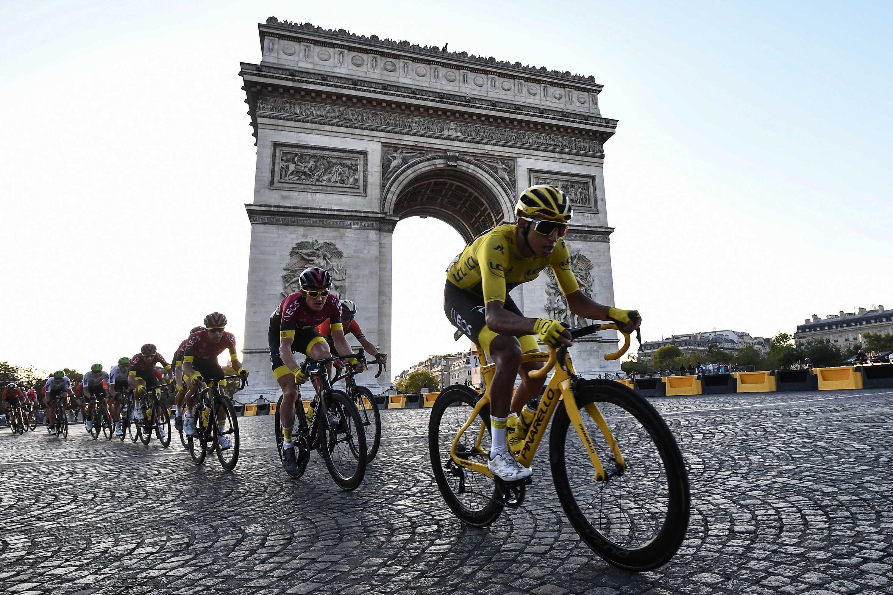 Cyclists ride down the Champs Elysees during the last stage of the 106th edition of the Tour de France in Paris, on July 28, 2019.