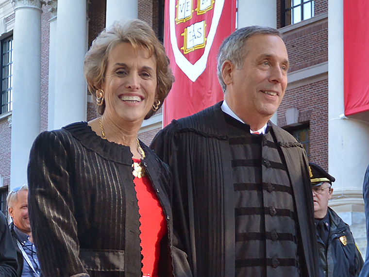 Lawrence Bacow, right, and his wife Adele Fleet Bacow leave Harvard Yard after his inauguration as the 29th President of Harvard University, Friday, October 5, 2018 in Cambridge, Massachusetts.