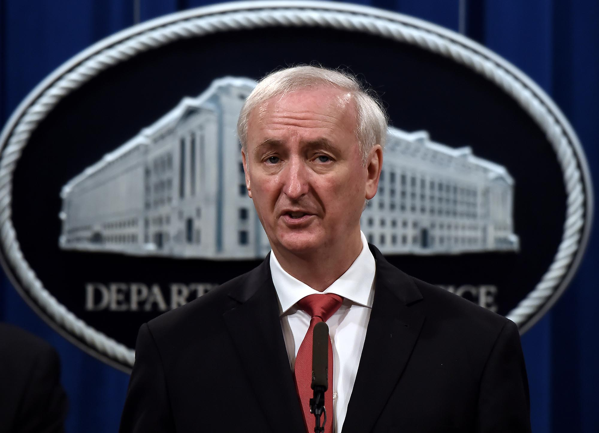 In this September 22, 2020, Jeffrey A. Rosen announces significant law enforcement actions related to the illegal sale of drugs and other illicit goods and services on the Darknet during a press conference at the Department of Justice in Washington.