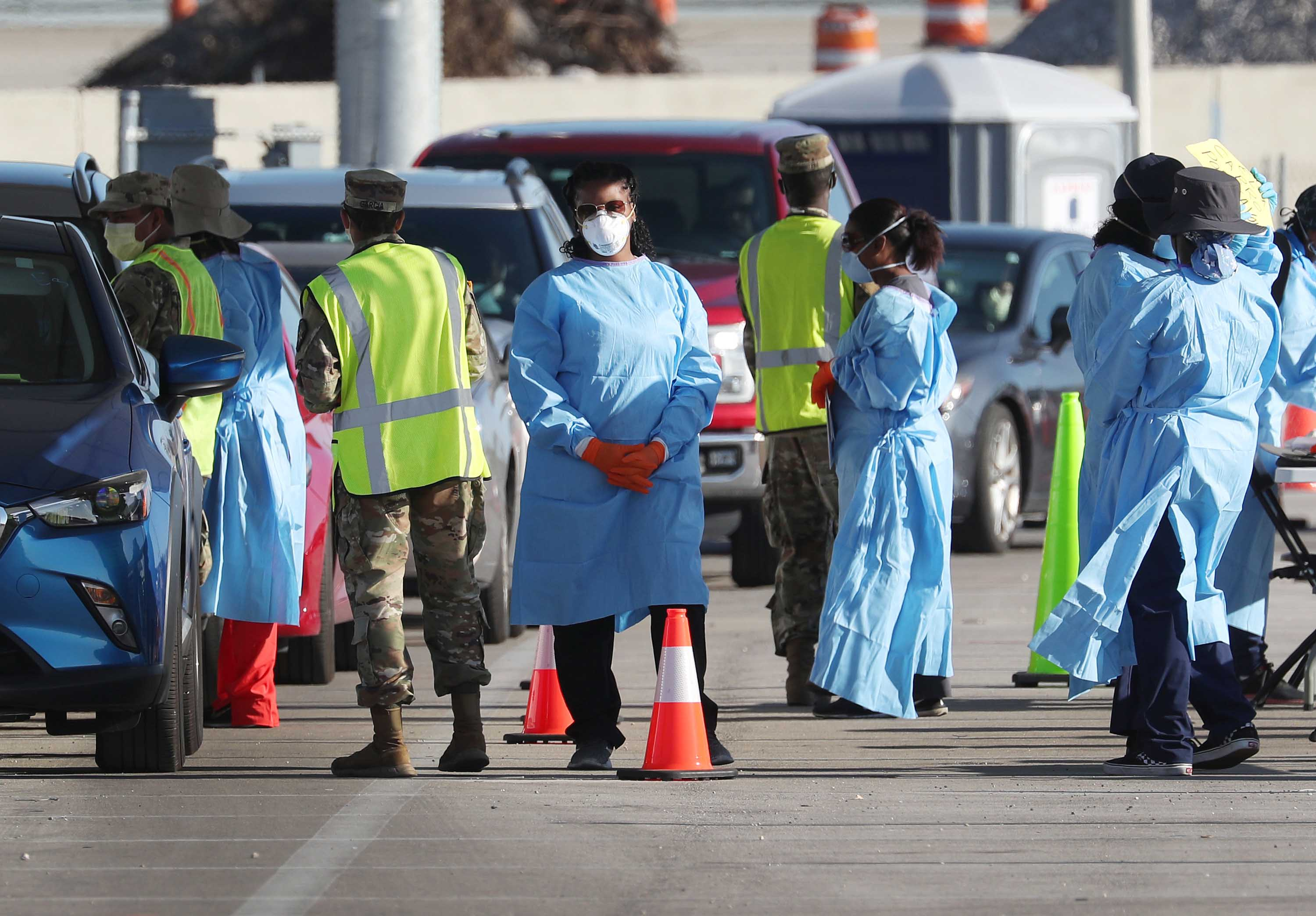 Health care workers check in people at a testing site setup by the the Florida National Guard, in Miami Gardens, Florida, on March 30.