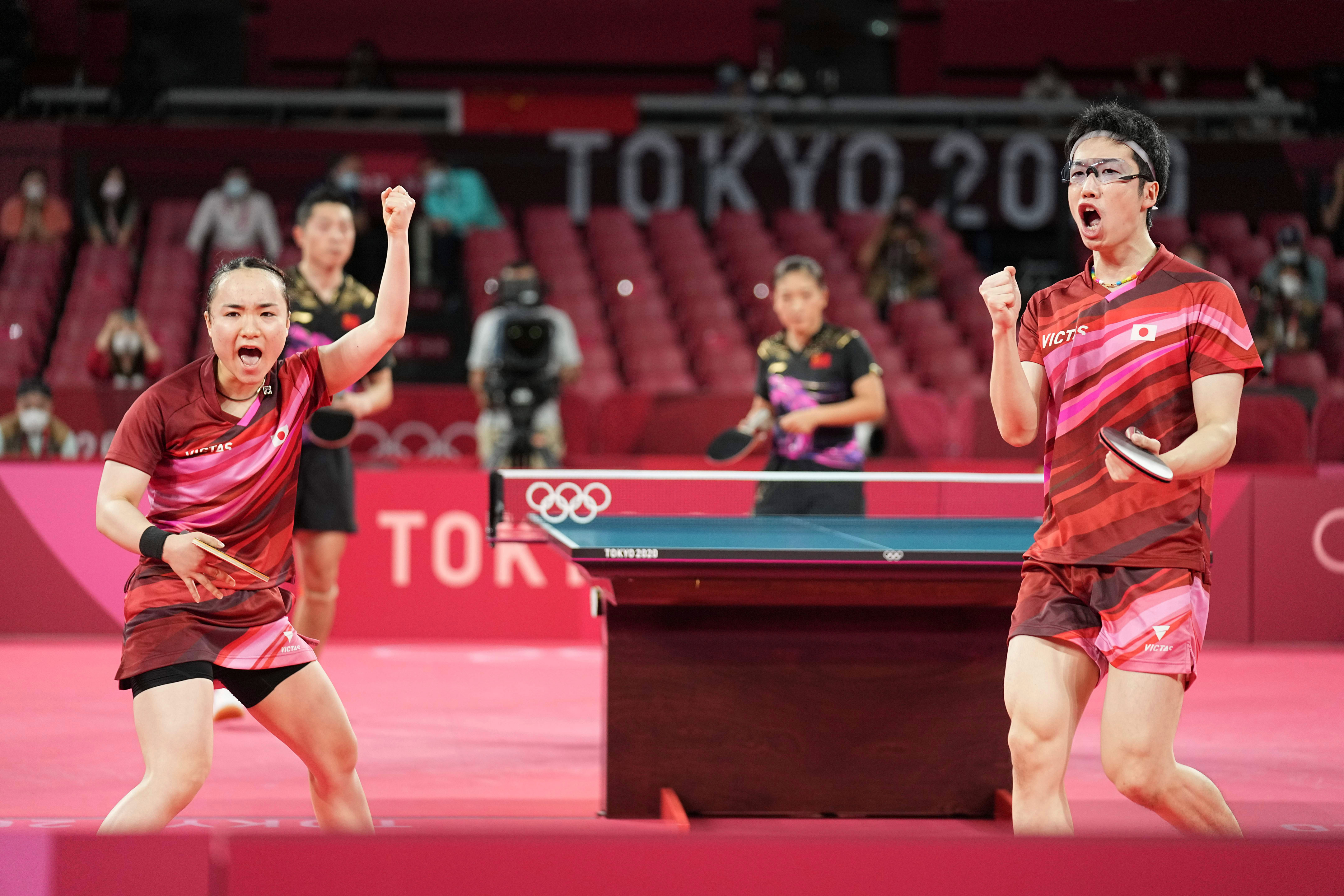 Japan's Mizutani Jun and Mima Ito react during their table tennis mixed doubles gold medal match against China on July 26.