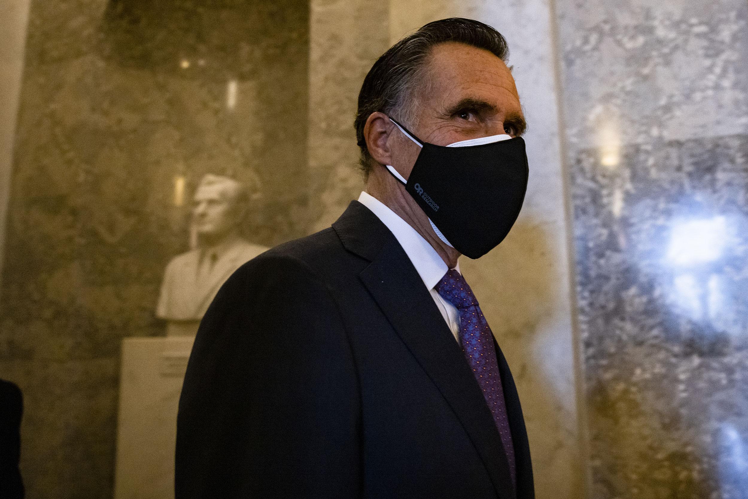Sen. Mitt Romney walks to the Senate floor on January 1.