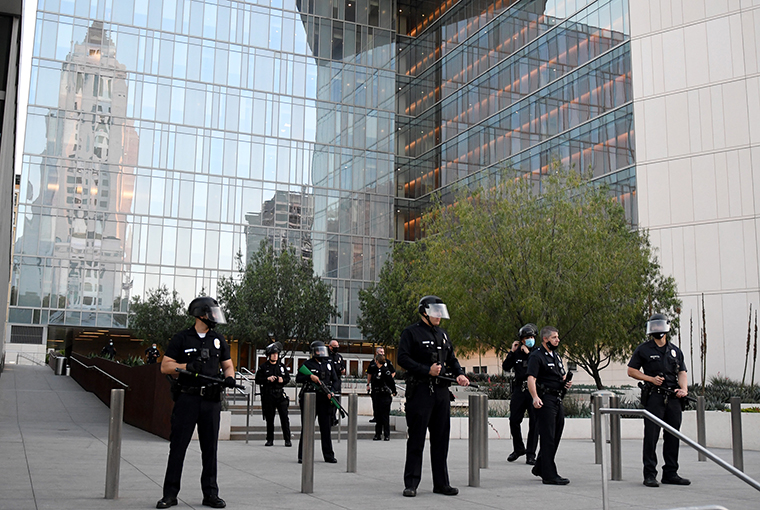 LAPD officers stand guard outside the Police Headquarters  in Los Angeles on Thursday, May 28.
