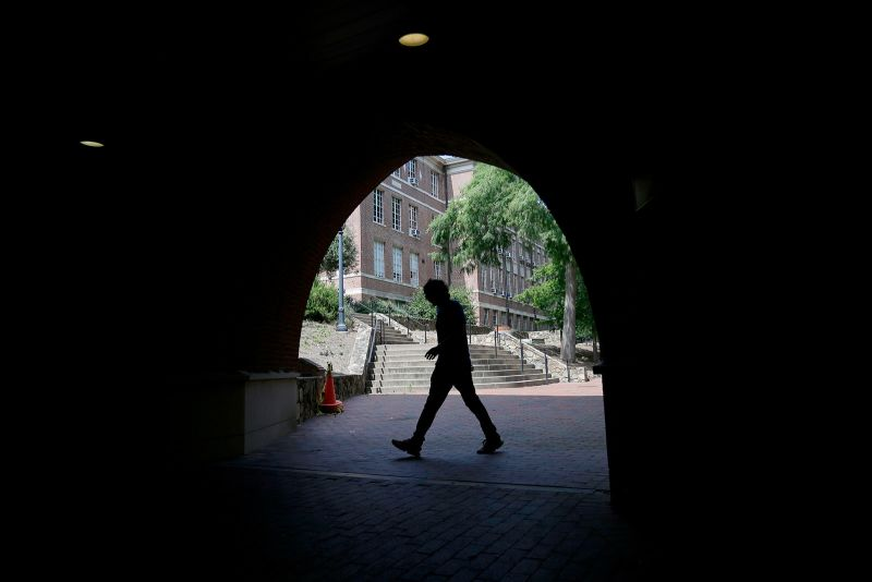 A pedestrian walks though a tunnel at the University of North Carolina in Chapel Hill in June.