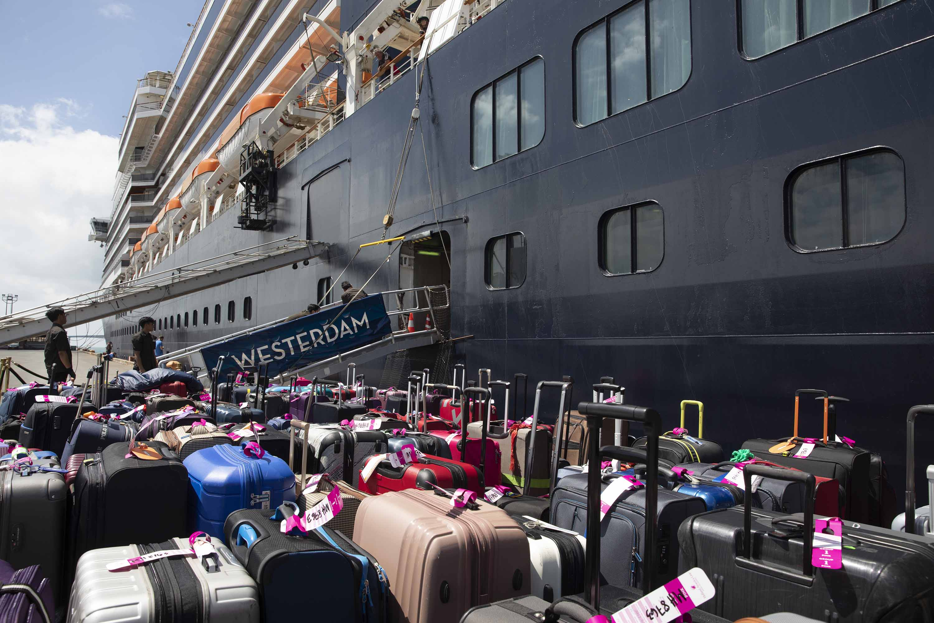 Luggage is prepared as some passengers disembark the MS Westerdam cruise ship docked in Sihanoukville, Cambodia on February 14.