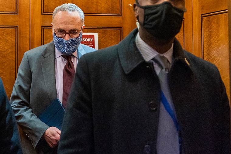 Senate Majority Leader Chuck Schumer of N.Y, takes the elevator in the U.S. Capitol, Friday, Jan. 22, 2021, in Washington.