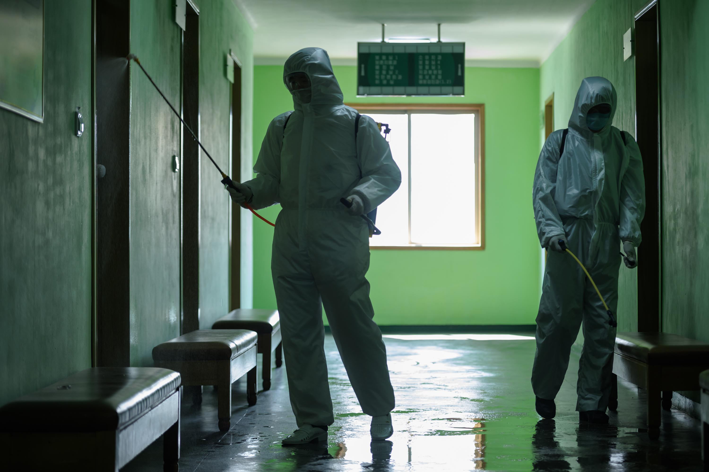 Health officials disinfect a corridor at the Pyongchon District People's Hospital in Pyongyang, North Korea, in April.