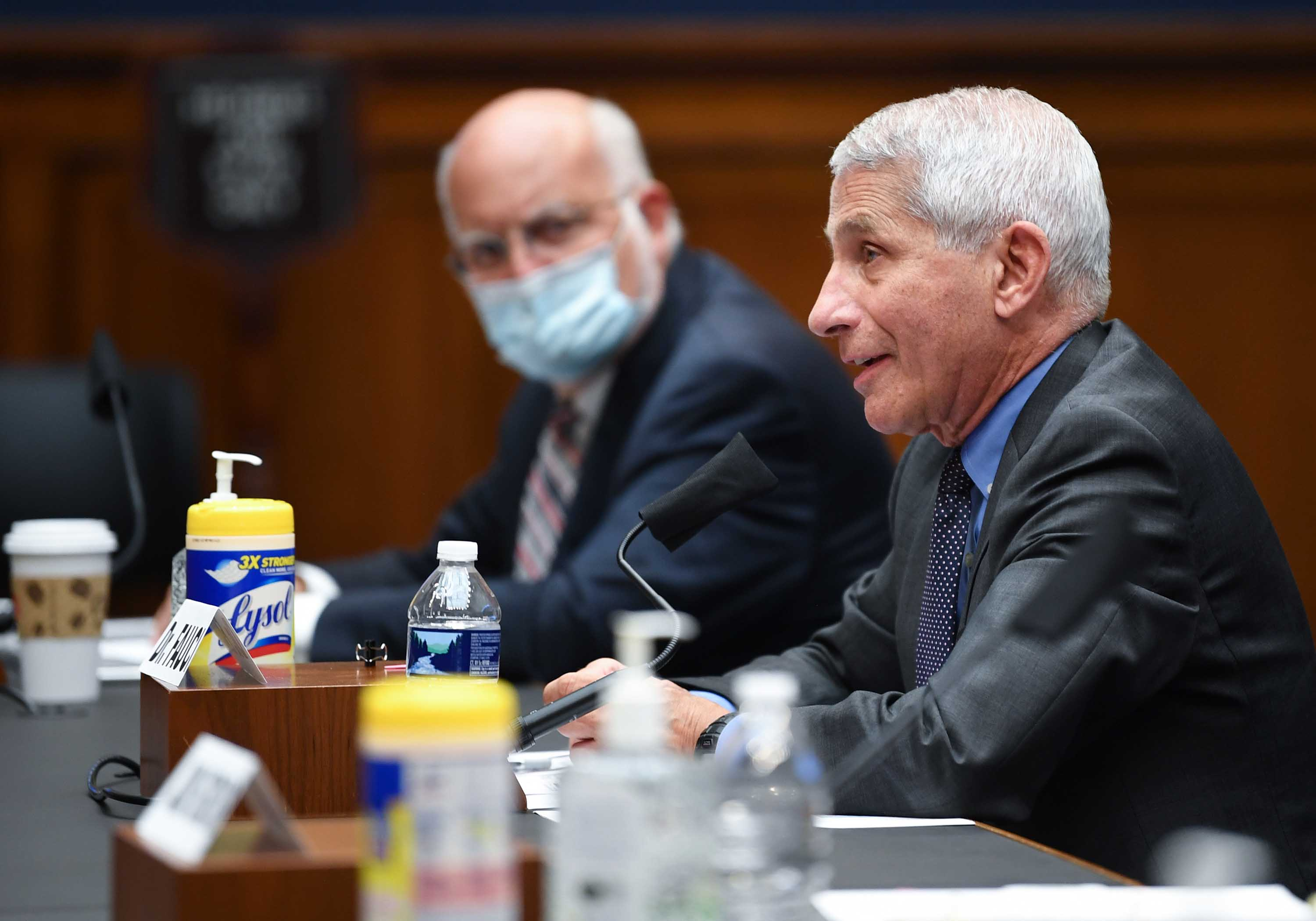Dr. Robert Redfield, left, listens as Dr. Anthony Fauci testifies before the US Senate Health, Education, Labor, and Pensions Committee hearing to examine Covid-19 on Capitol Hill in Washington on June 23.