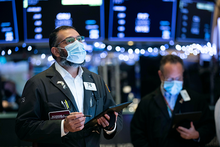 Traders working on the floor of the New York Stock Exchange on Tuesday, Jan. 5, 2021.