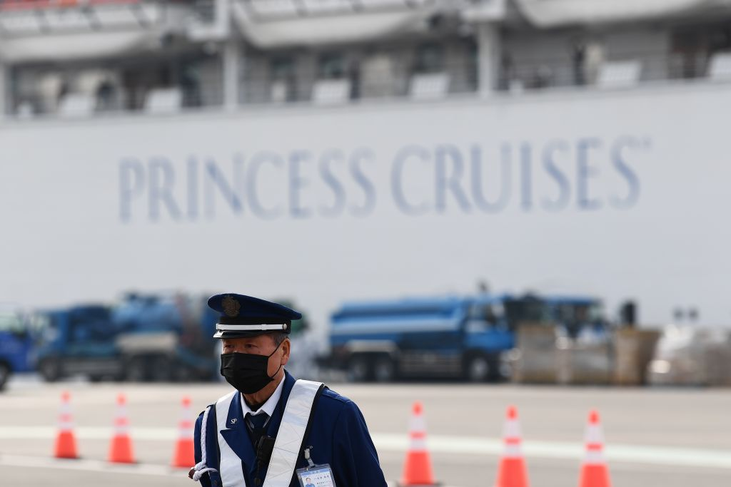 Passengers are seen on balconies of the Diamond Princess cruise ship, with thousands of people quarantined onboard due to fears of the new coronavirus, at the Daikoku Pier Cruise Terminal in Yokohama port on February 14.