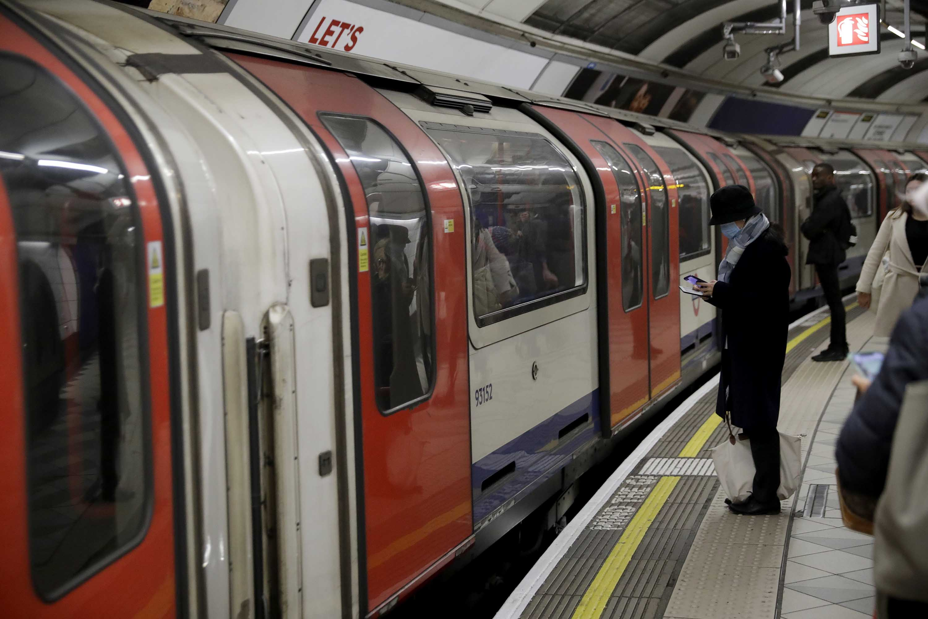 People wait to board an underground train in London, England, on March 4.