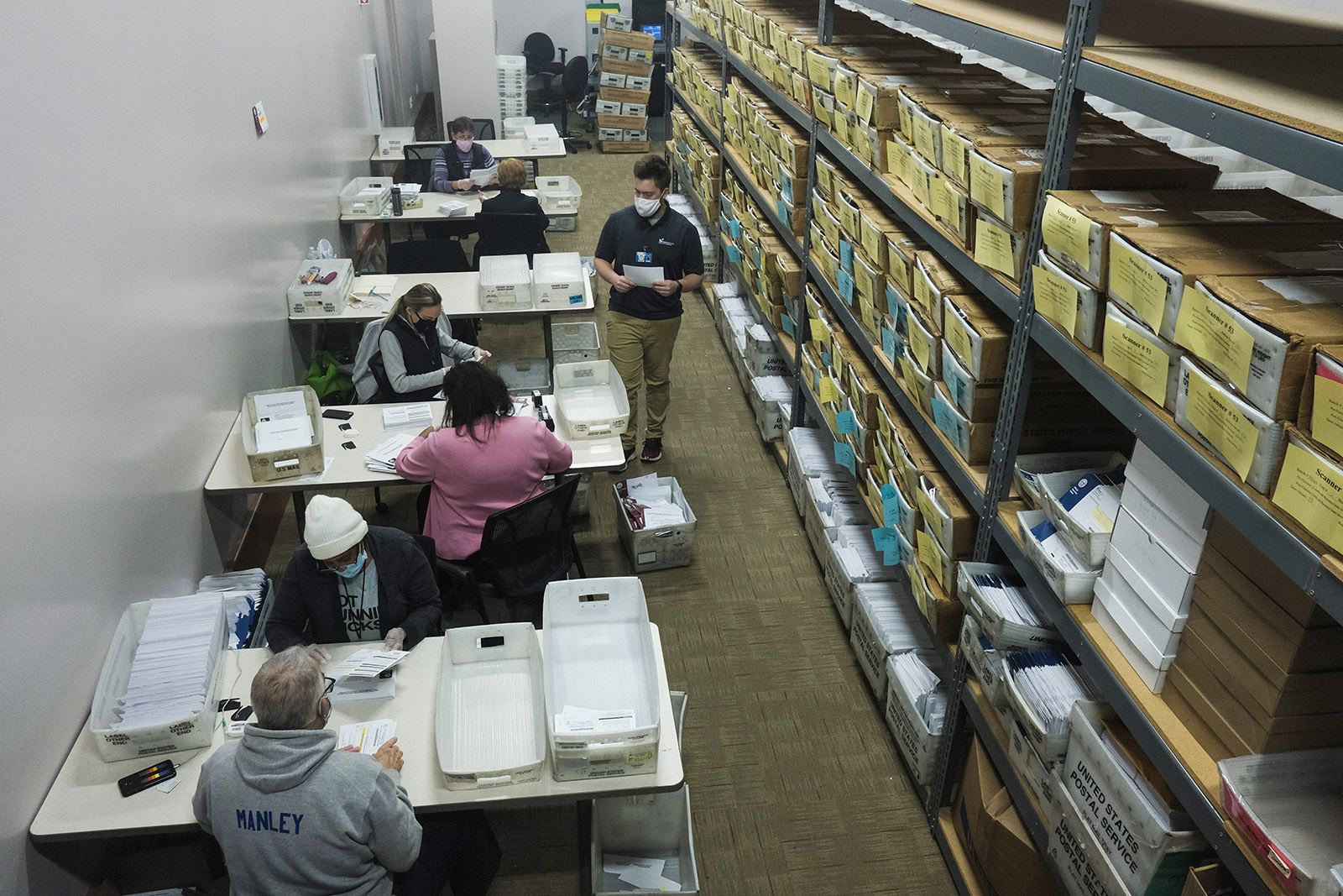 Election workers open and count ballots to be processed at the Franklin County Board of Elections on November 3, in Columbus, Ohio.