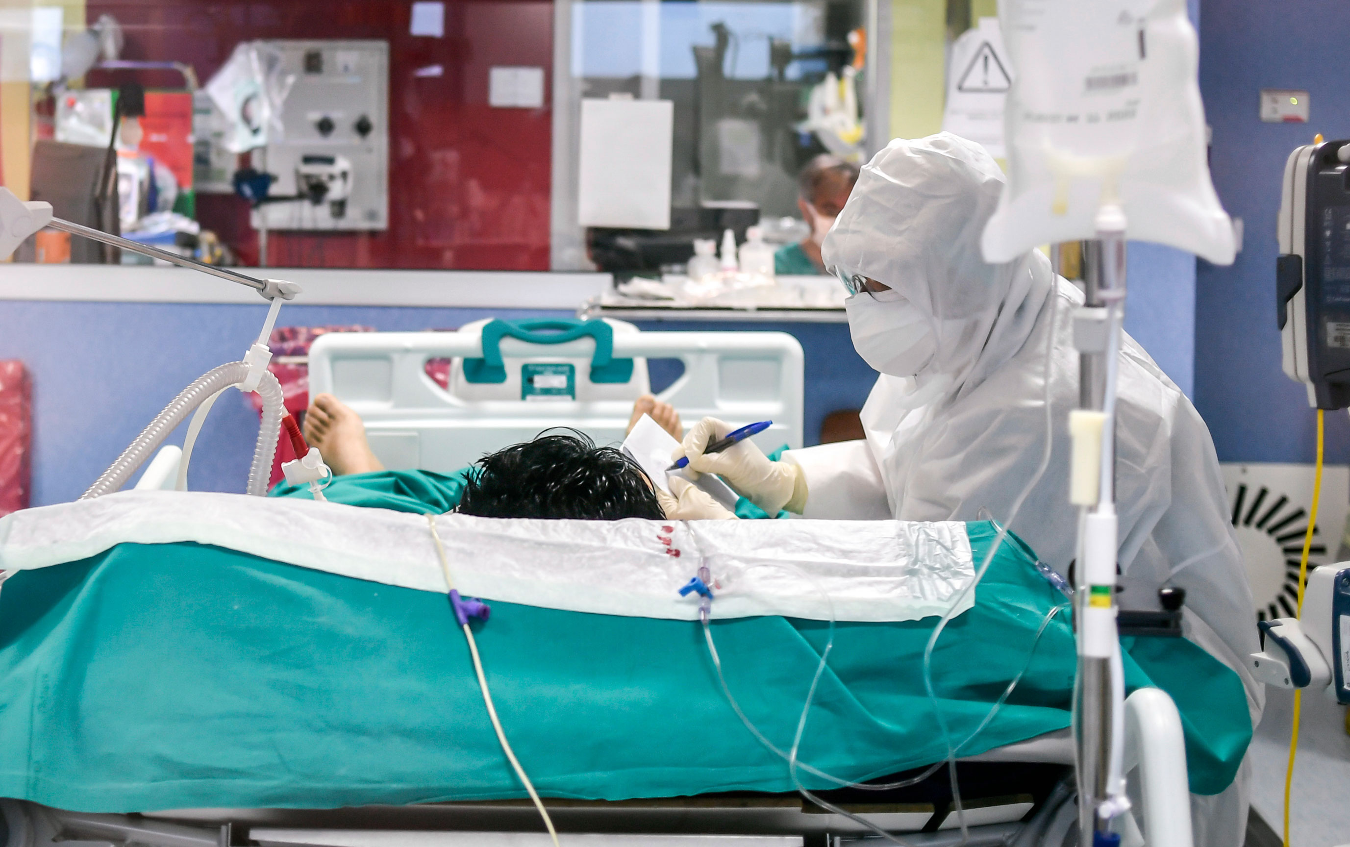 A medical worker tends to a patient in the ICU of the Bassini Hospital, in Cinisello Balsamo, Italy, on April 14.