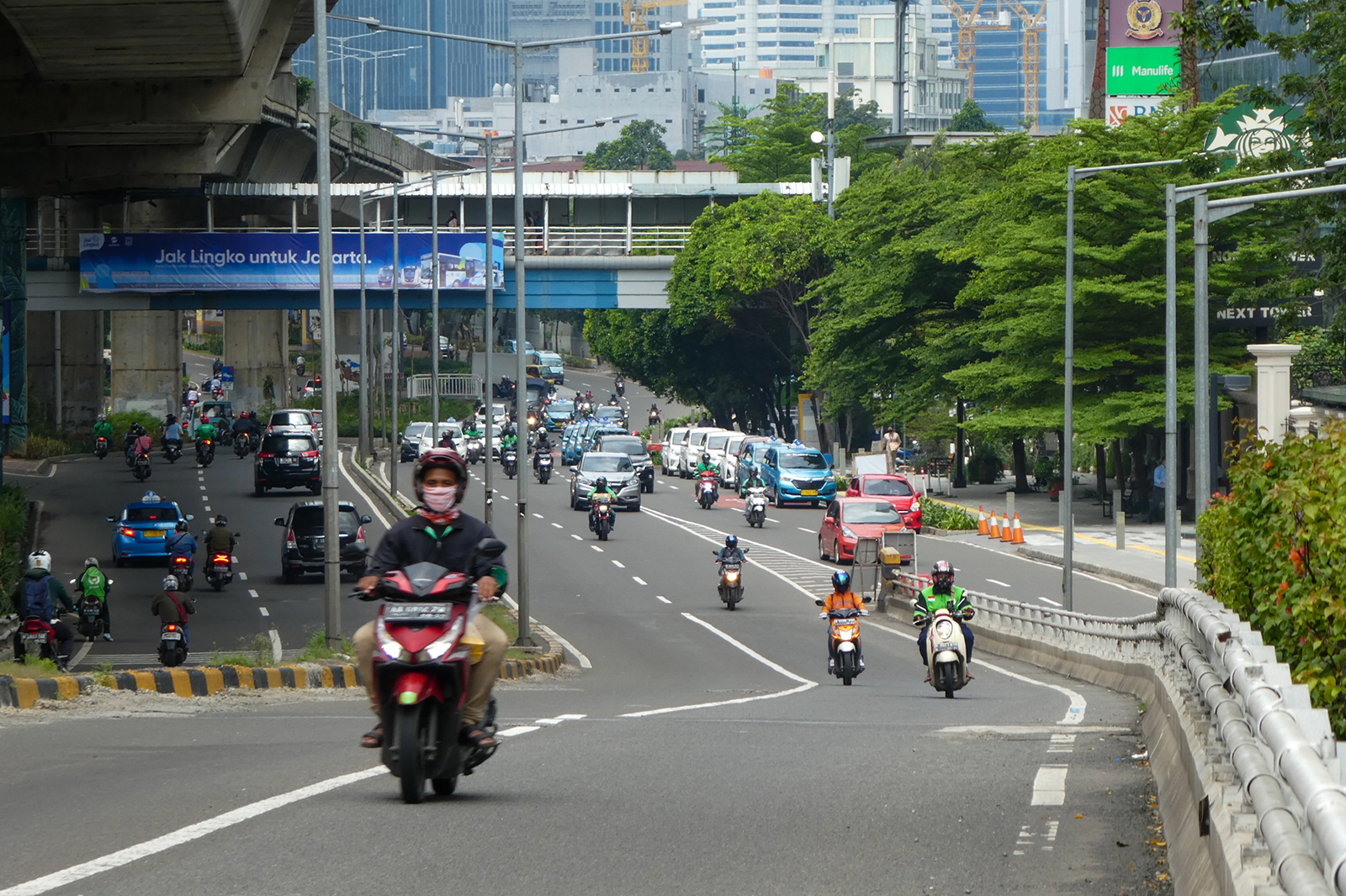 Motorists travel on a usually busy road during lunch hour in Jakarta on April 14.