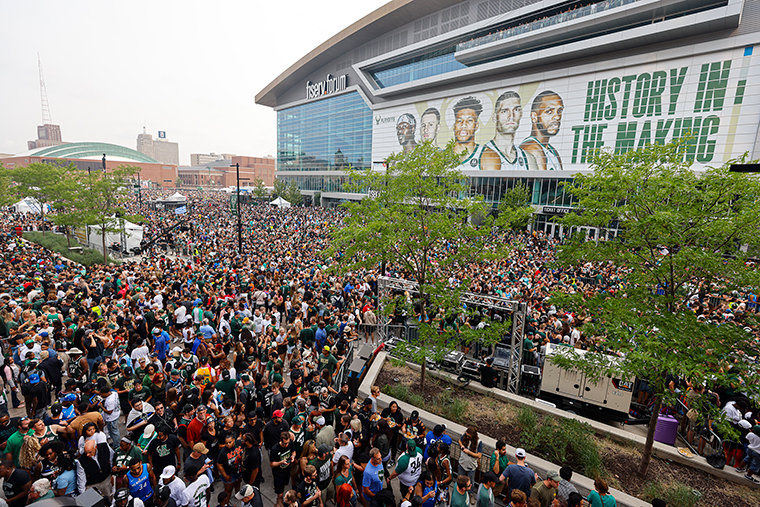 Fans make their way into the Deer District before Game 6 of the NBA basketball finals game between the Milwaukee Bucks and the Phoenix Suns on Tuesday, July 20.