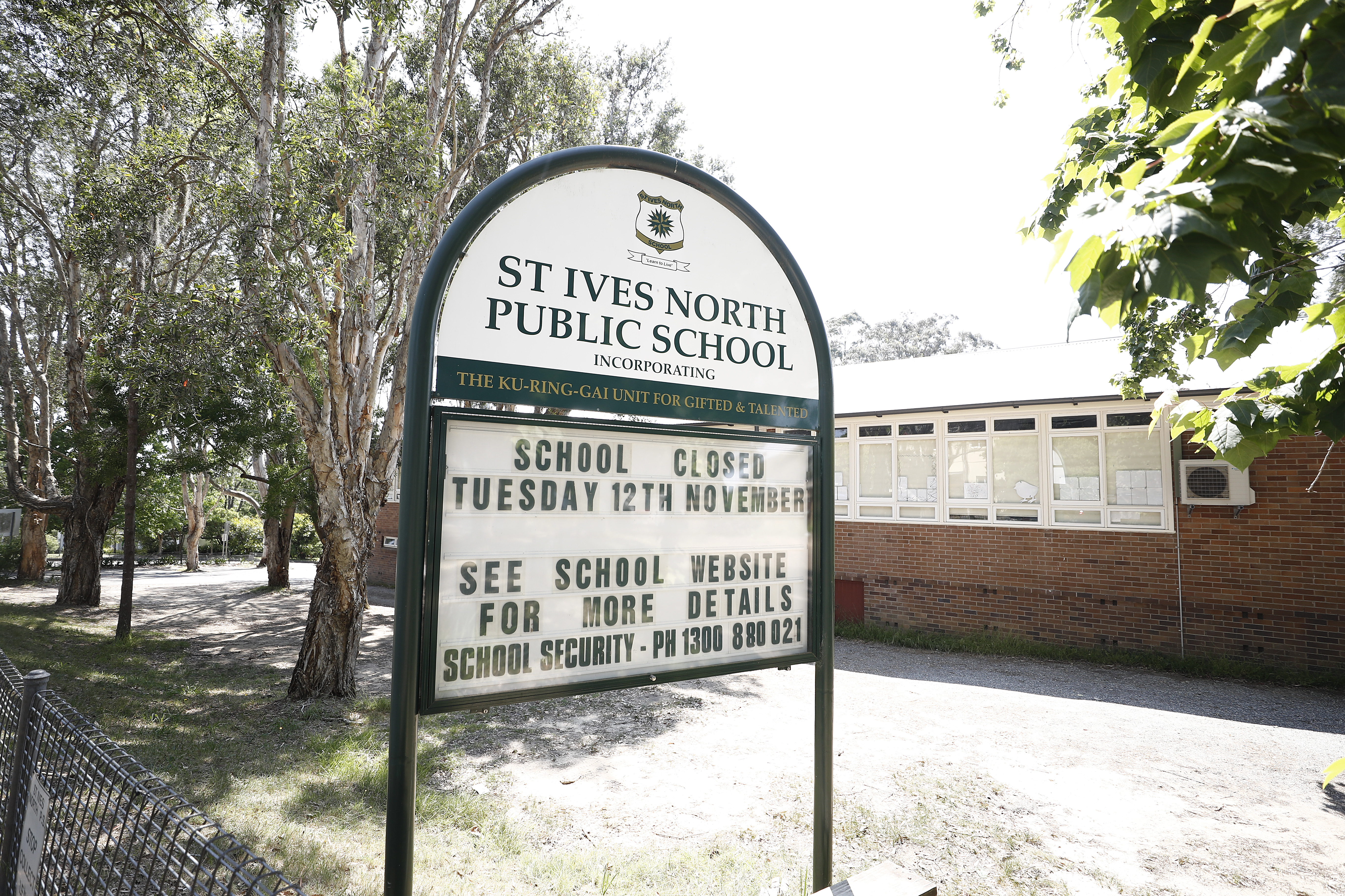 A sign displays information about the closure of St Ives North Public School on November 12 in Sydney.